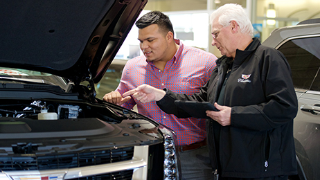 A Service Advisor performs a service walk around with a guest at Sonic Automotive's Cadillac of South Charlotte.