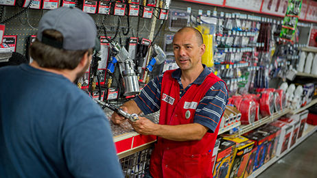 Tractor Supply Company team member assisting a customer inside a Tractor Supply Company store.
