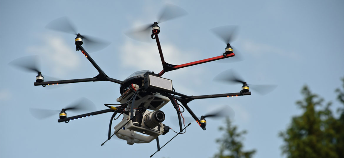 An octo-copter drone carrying an electronic scanning array radar typically far too large, expensive, and power hungry for such a small aircraft.