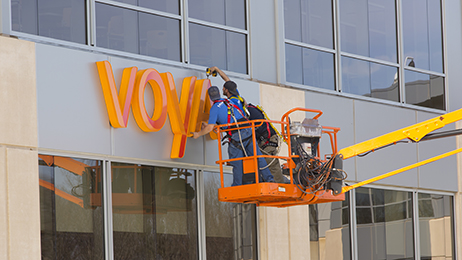 Workers install a new sign outside Voya Financial's offices in Windsor, Connecticut.