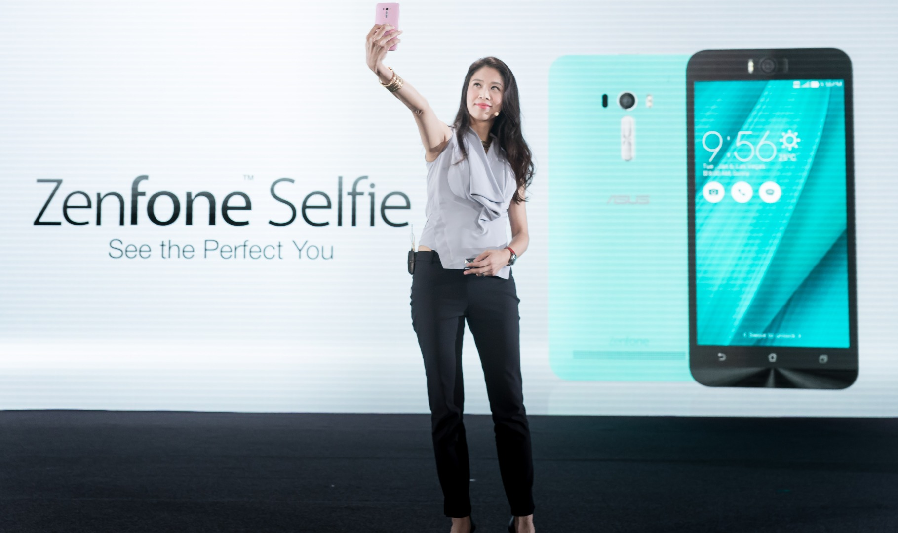ASUS design center director Jen Chuang demonstrates the new ZenFone Selfie at the Computex conference in Taiwan on June 1, 2015.