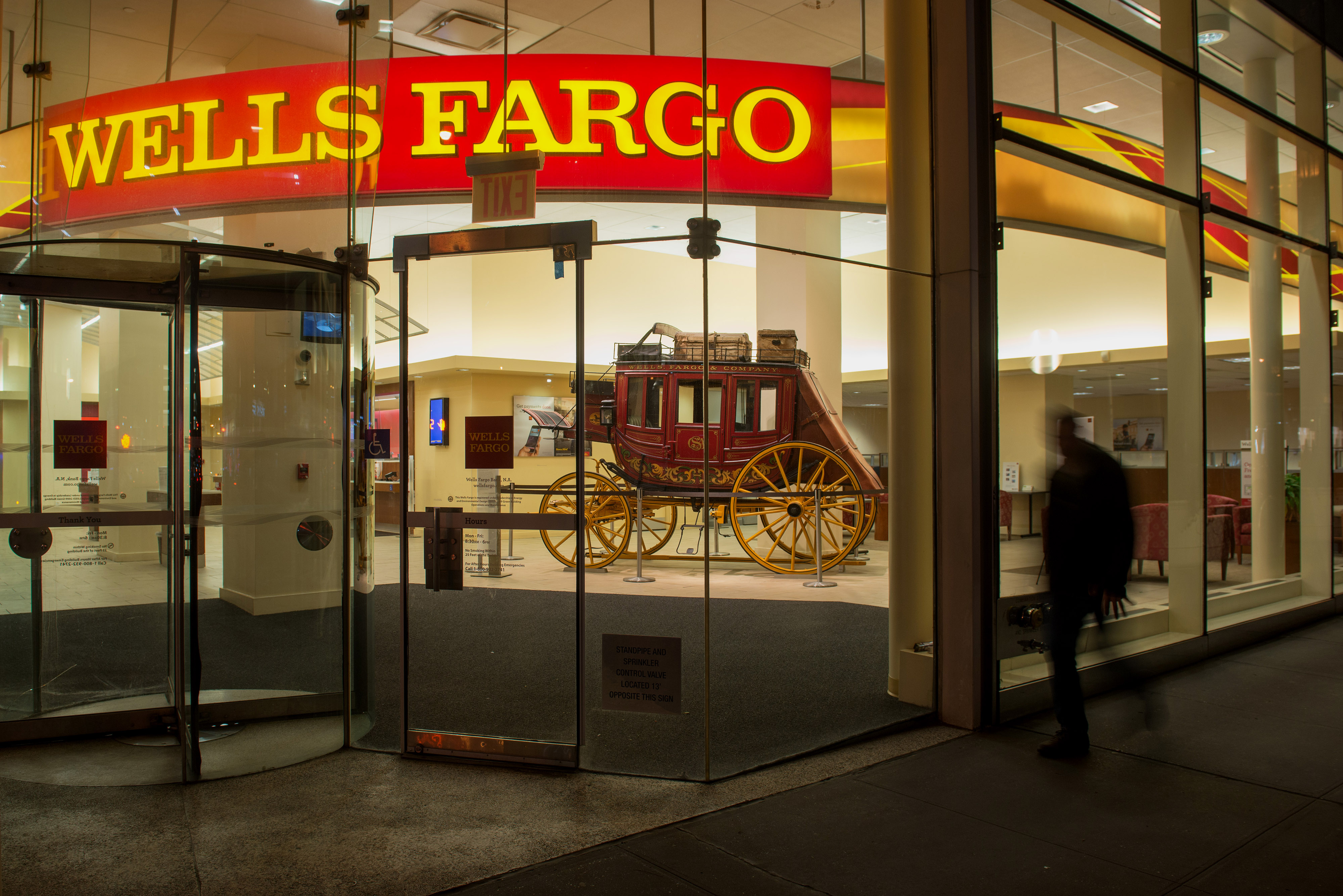 A Wells Fargo bank branch on Madison Avenue in Midtown Manhattan,  New York, U.S., on Saturday, April 11, 2015.  Photographer: Craig Warga/Bloomberg *** Local Caption ***
