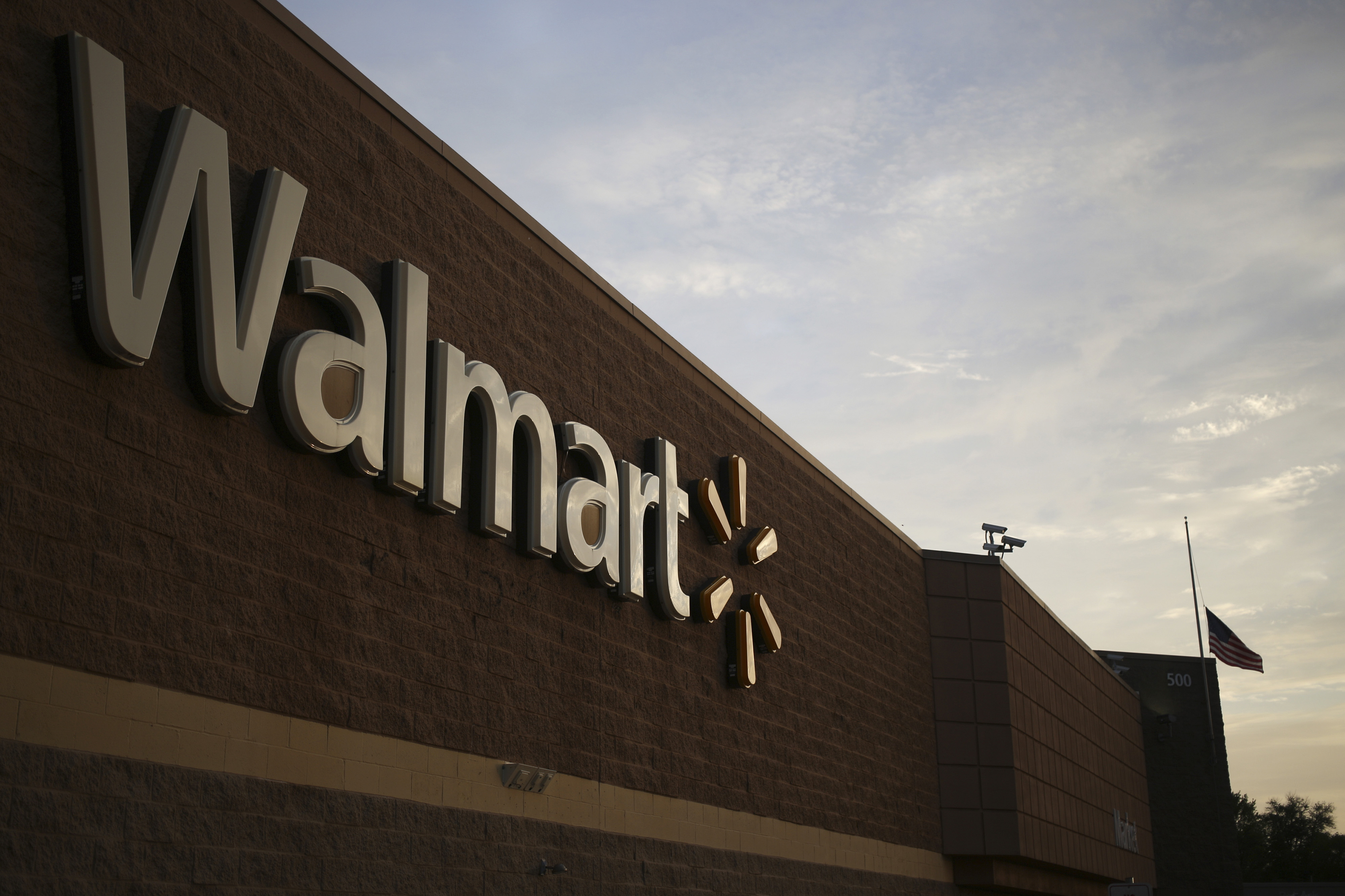 Signage is displayed on the exterior of a Wal-Mart Stores, Inc. retail location in Shelbyville, Kentucky, U.S. on Monday, May 18, 2015. Wal-Mart is expected to release quarterly earnings on Tuesday, May 19. Photographer : Luke Sharrett / Bloomberg