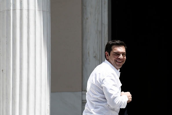 Alexis Tsipras, Greece's prime minister, smiles as he arrives at his office after returning from Brussels meetings in Athens, Greece, on Thursday, June 4, 2015. After meeting in Brussels with European Commission President Jean-Claude Juncker and Dutch Finance Minister Jeroen Dijsselbloem, who also heads the group of his euro-area counterparts, Tsipras stuck to his position that any basis for an accord must be a Greek proposal. Photographer: Kostas Tsironis/Bloomberg *** Local Caption *** Alexis Tsipras