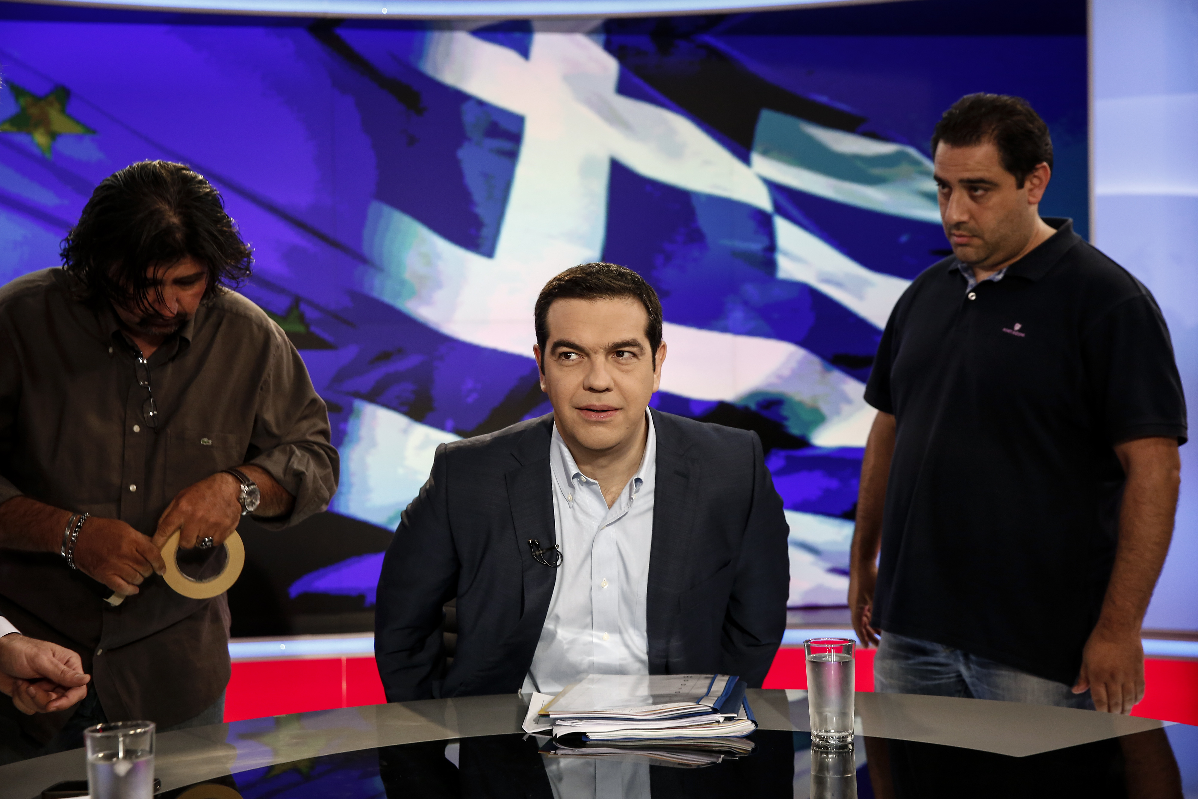 Greek Prime Minister Alexis Tsipras preparing for a TV interview late Monday, in which he promised Greeks that the Eurozone wouldn't dare expel their country from the Eurozone.