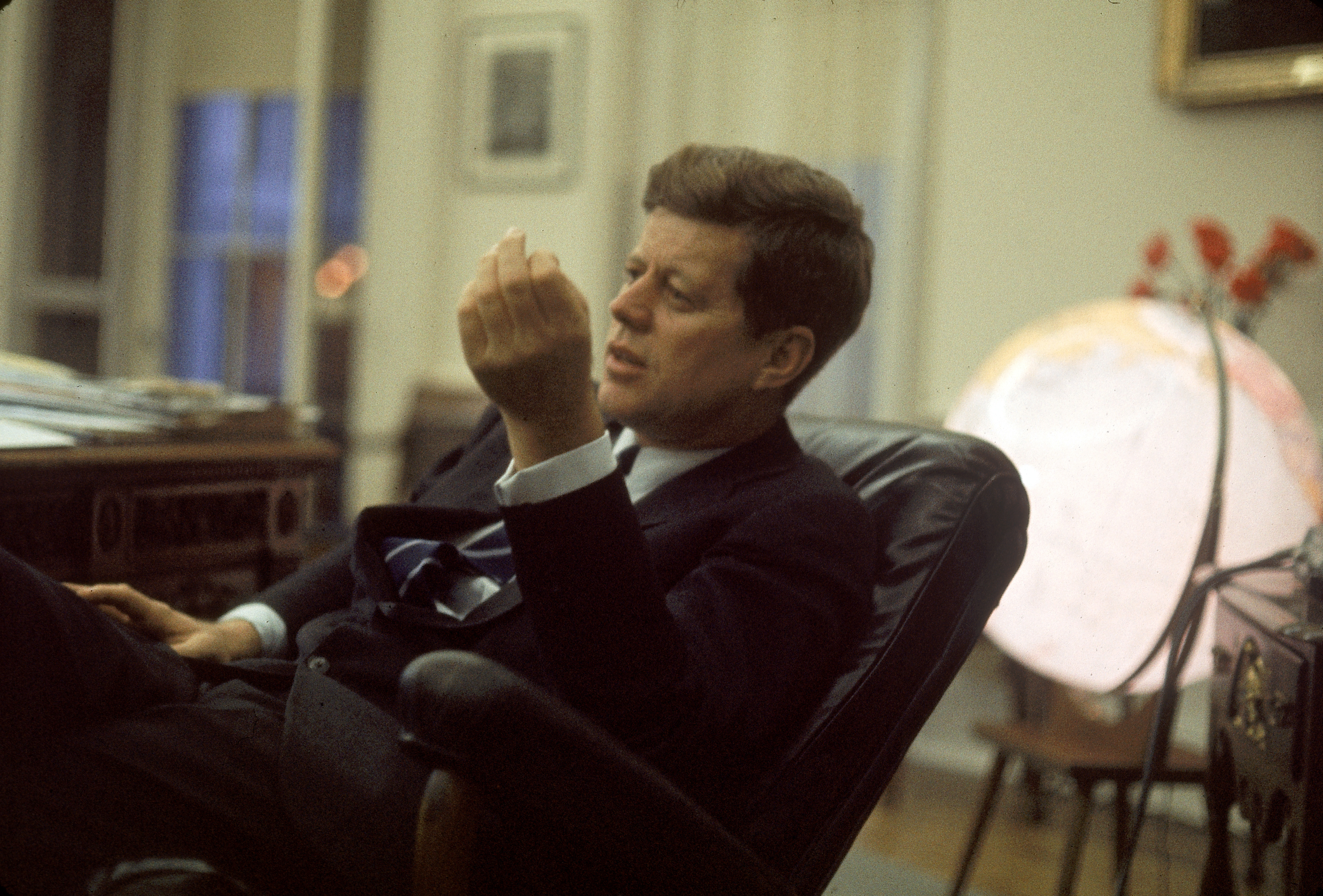 Pres. John F. Kennedy sitting in his White House o