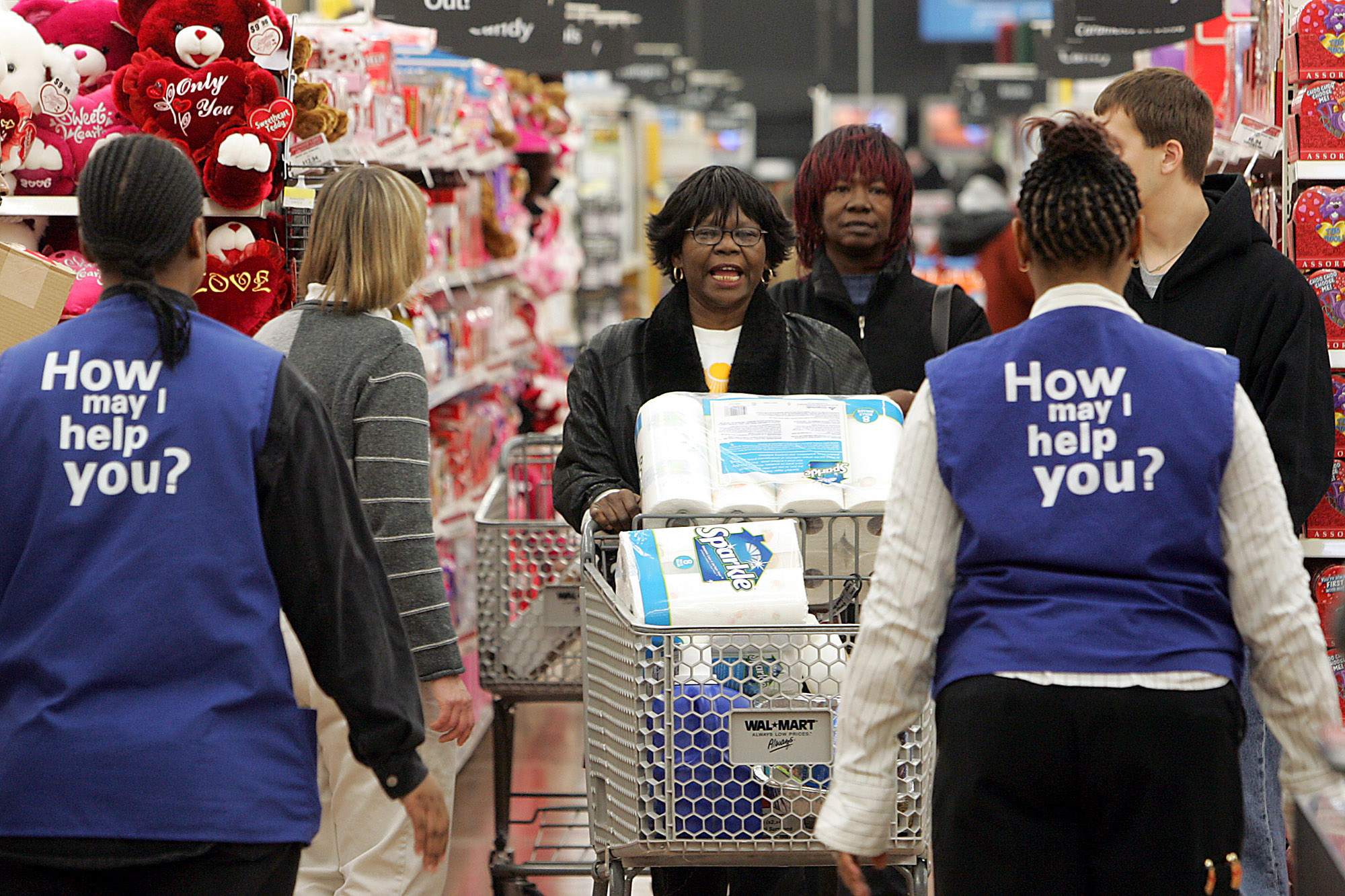 Phyllis McCrary, center, talks to store greeters while shopp