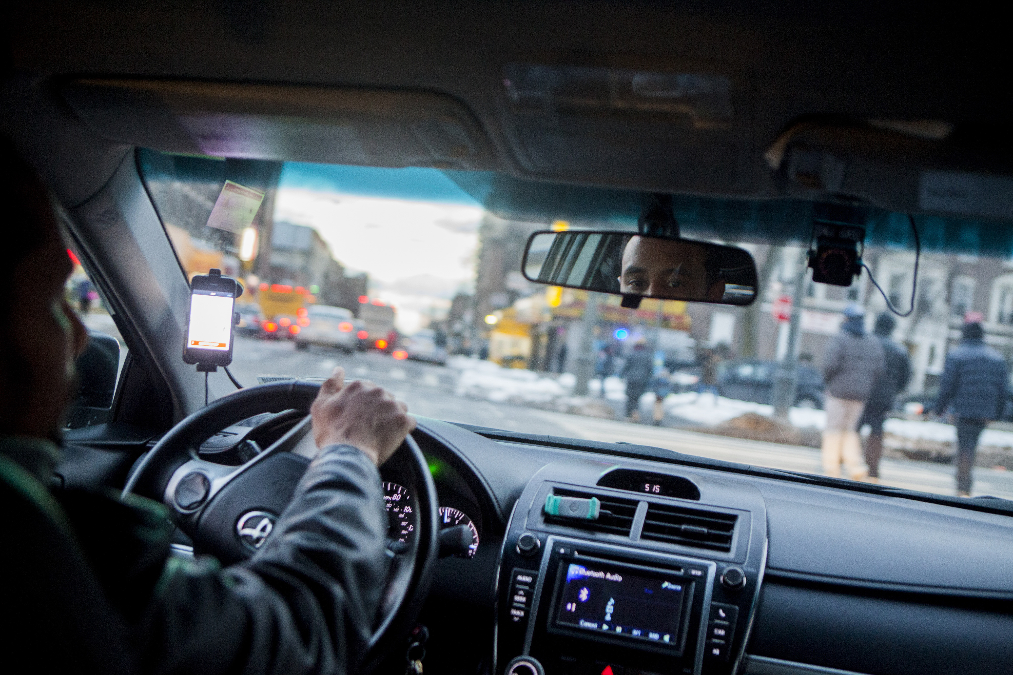 An Uber driver navigates the streets of Brooklyn?s Crown Heights neighborhood.