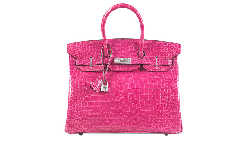 The crocodile-skin Hermes Birkin bag broke the record for the most expensive handbag sold at auction, selling for $222,912 at a Christie's auction in Hong Kong.
