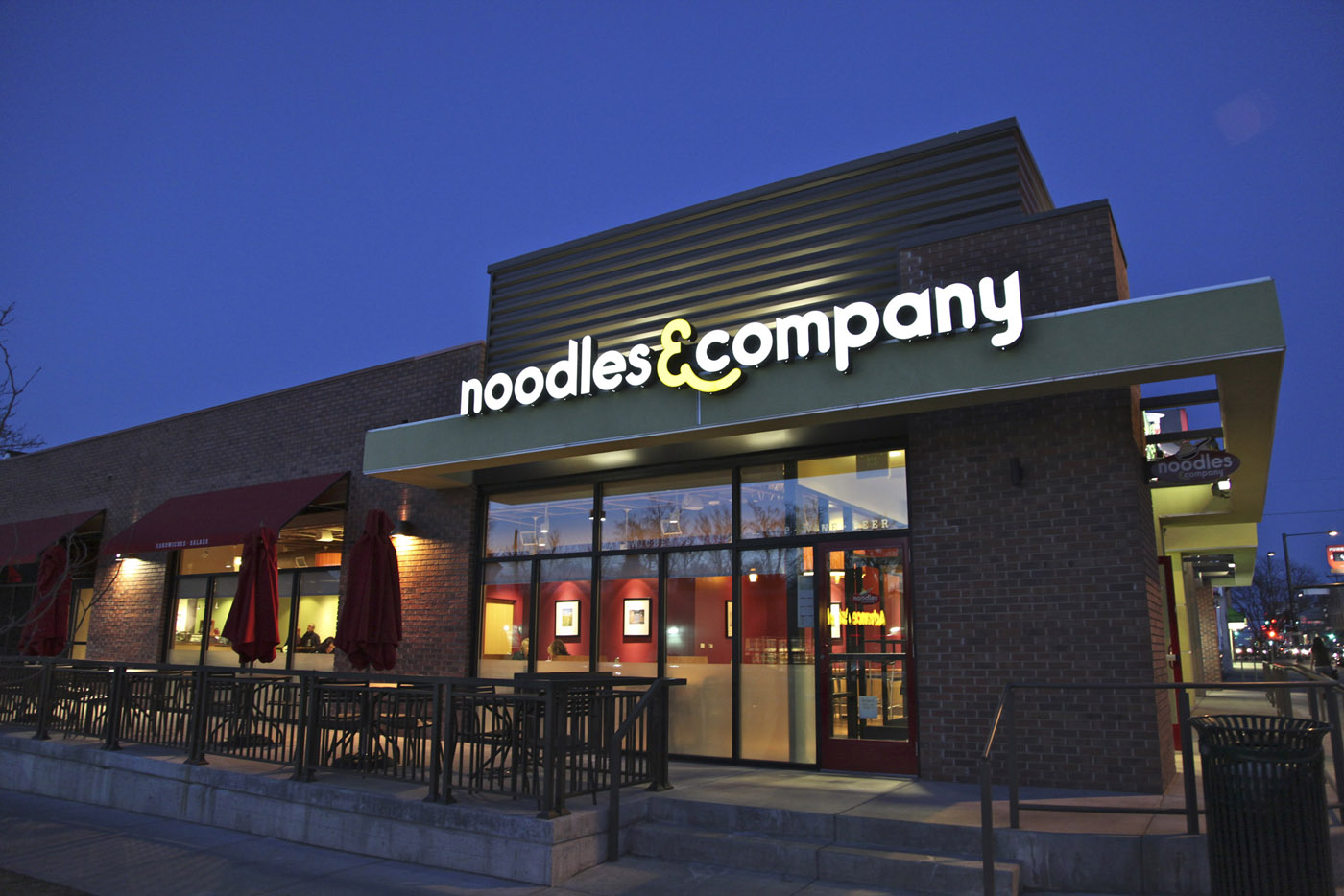 A top Noodles & Co. executive is resigning to become CEO of a hot dog purveyor.