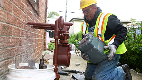 Peoples Gas employee installs a new outdoor meter and regulator for a customer on the North Side of Chicago. Peoples Gas is a subsidiary of Integrys Energy Group.