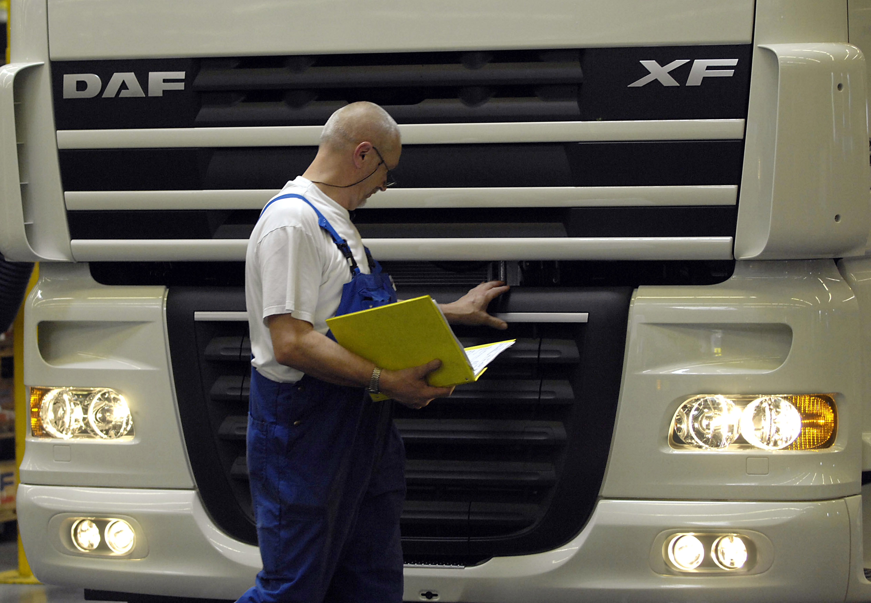 A worker monitors production at the DAF Trucks NV factory in