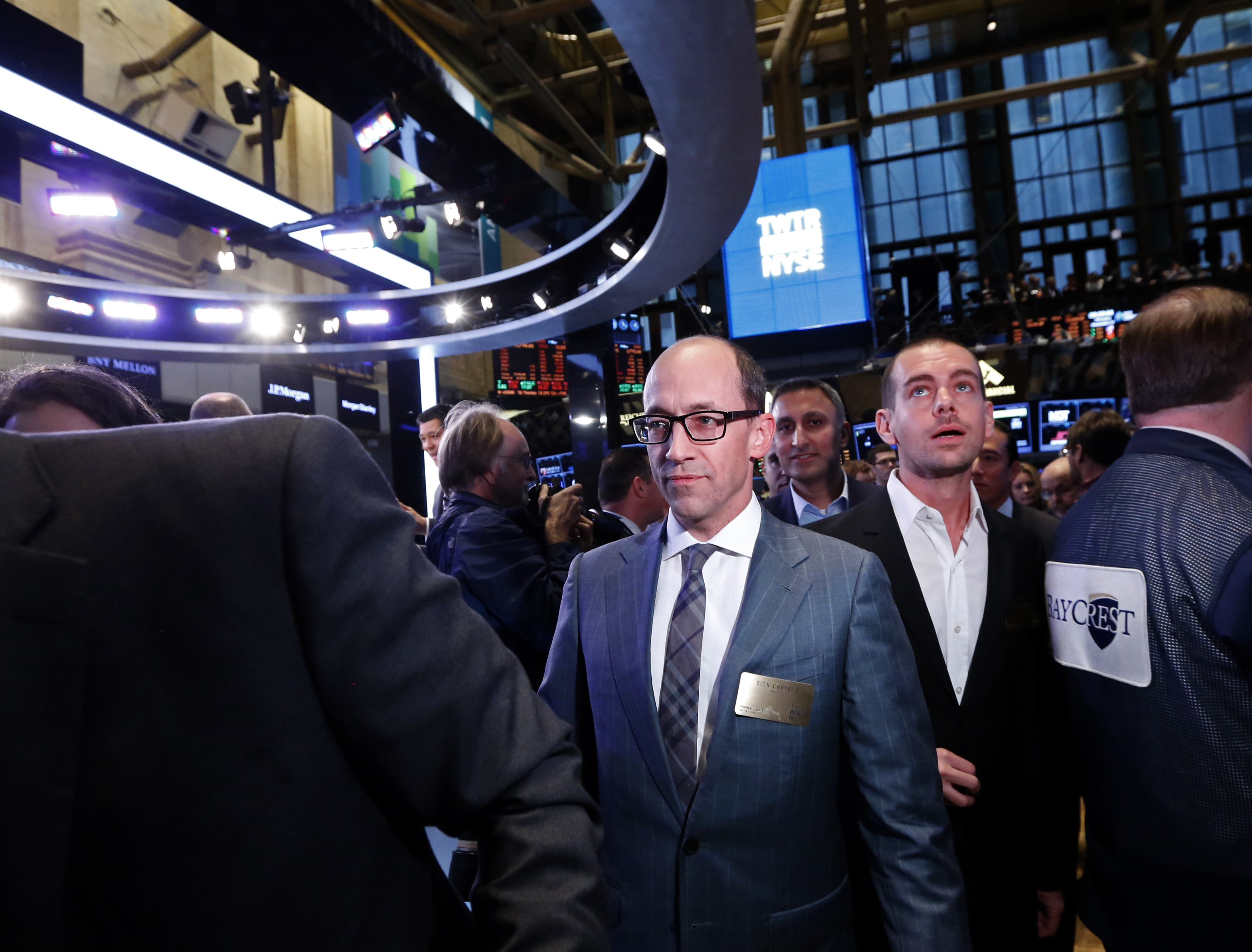 Twitter CEO Costolo and Twitter co-founder Dorsey walk the floor of the New York Stock Exchange during Twitter's IPO in New York