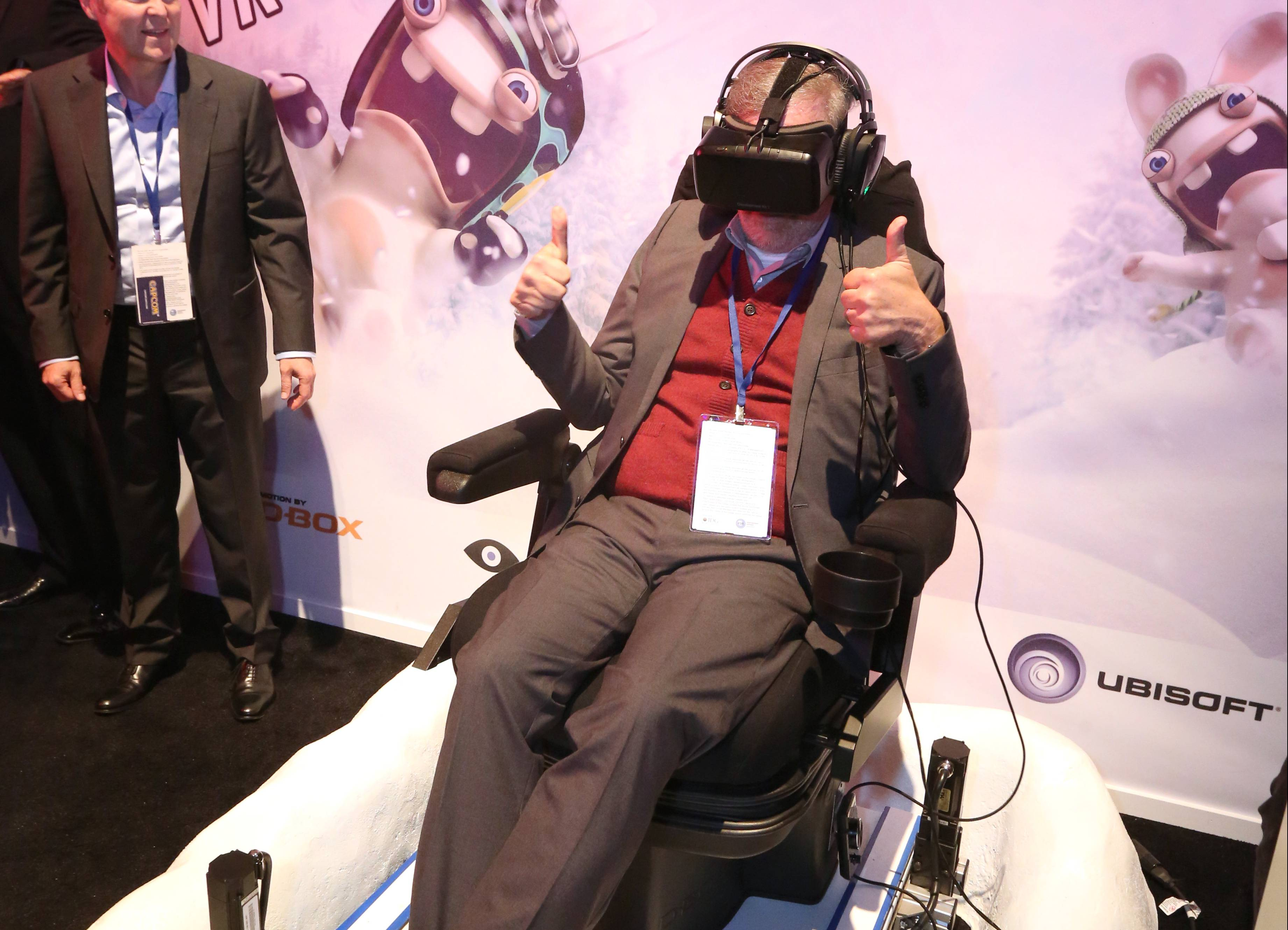 Steven Spielberg plays Rabbids VR Ride at the Ubisoft booth at E3 2015