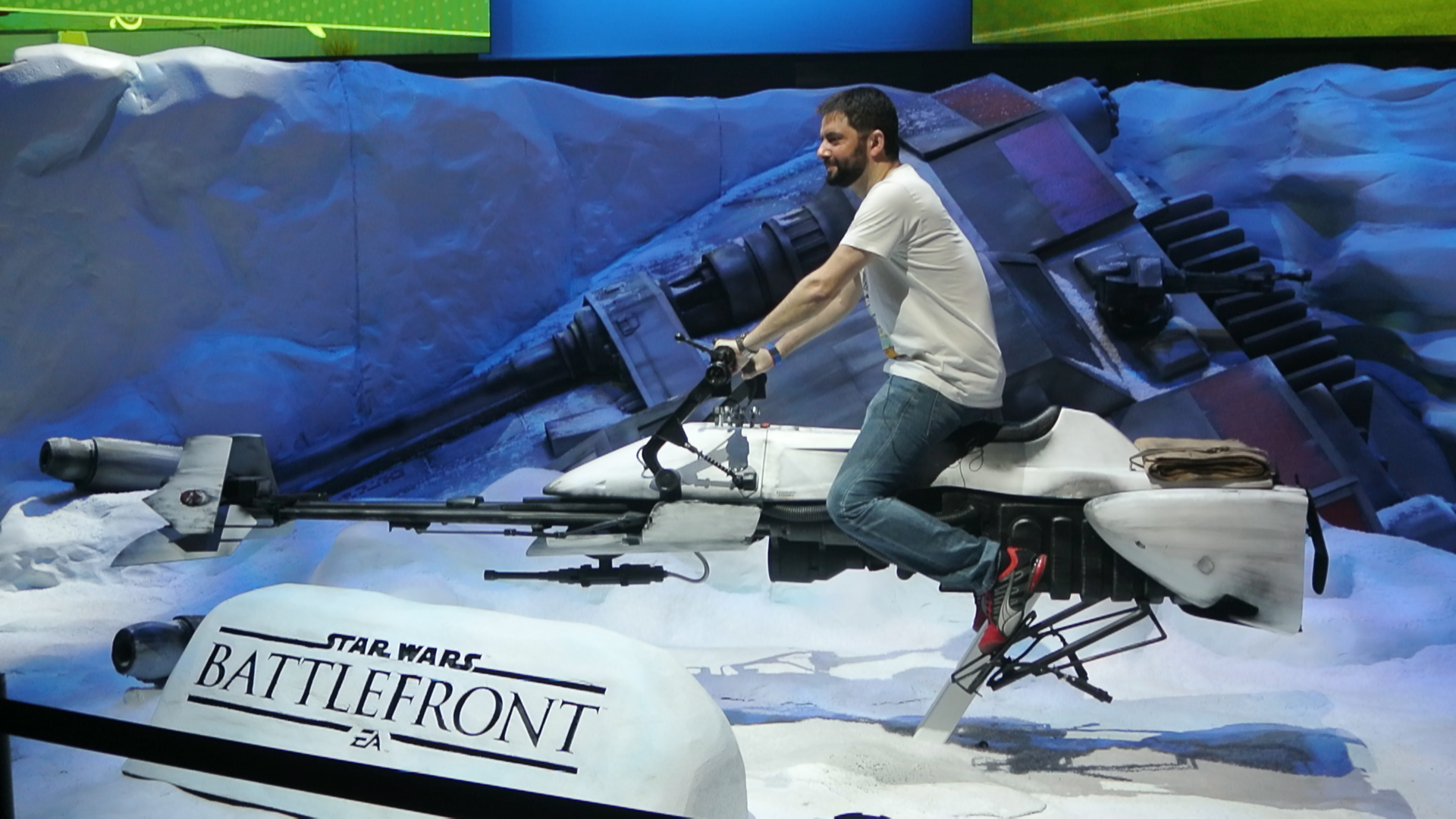 A fan rides a speeder bike at Electronic Arts' Star Wars Battlefront booth at E3 2015