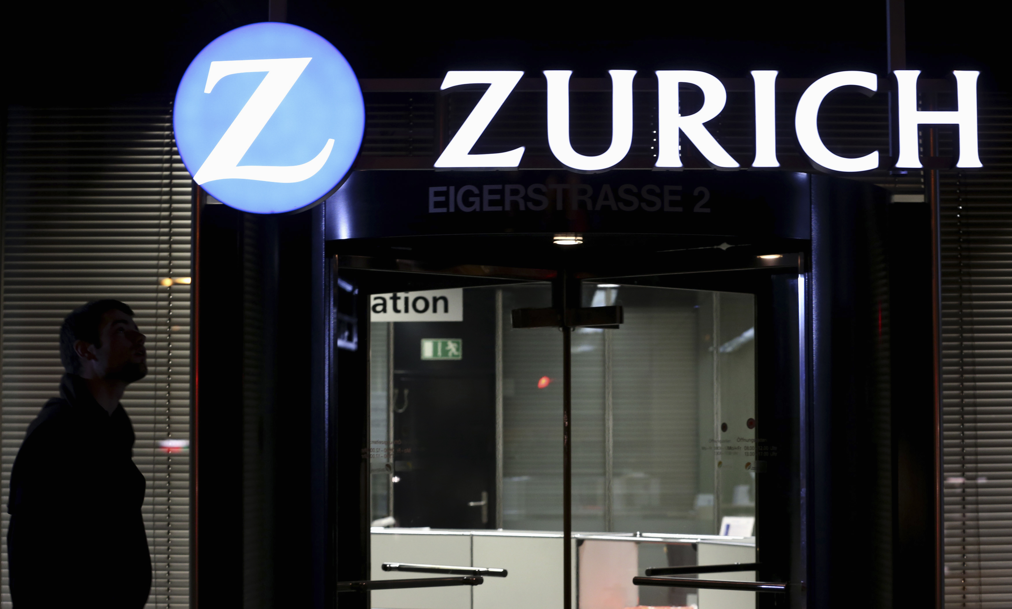 The logo of Zurich Insurance Group is seen on a building in Bern