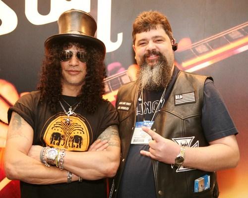 Dalrymple, right, with rock guitarist Slash