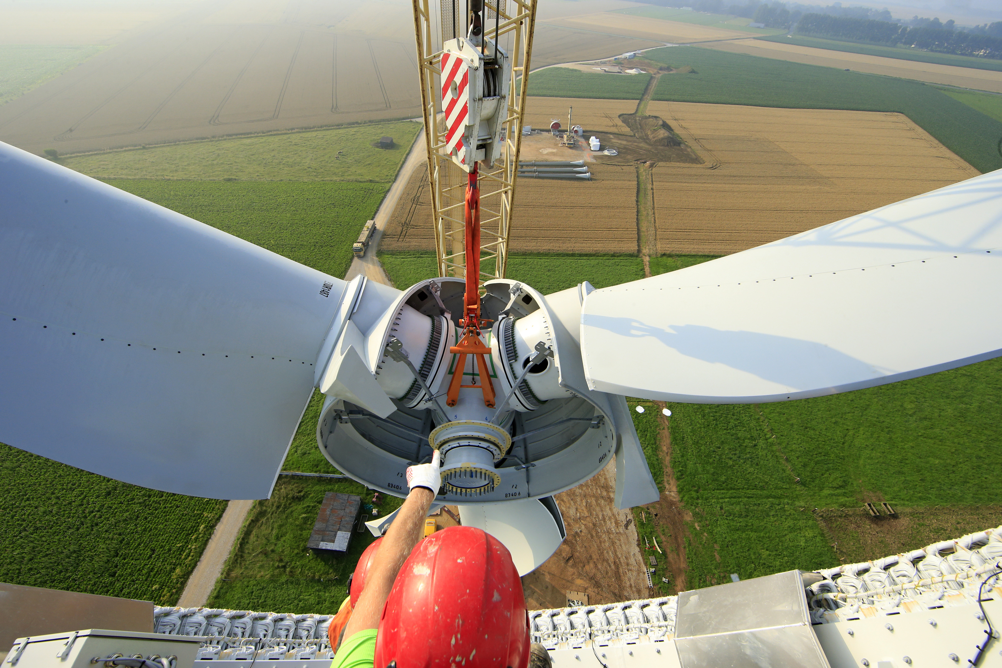 A worker installed in the nacelle controls the assembling of the rotor hub of an E-70 wind turbine manufactured by German company Enercon for La Compagnie du Vent during its installation at a wind farm in Meneslies, Picardie region