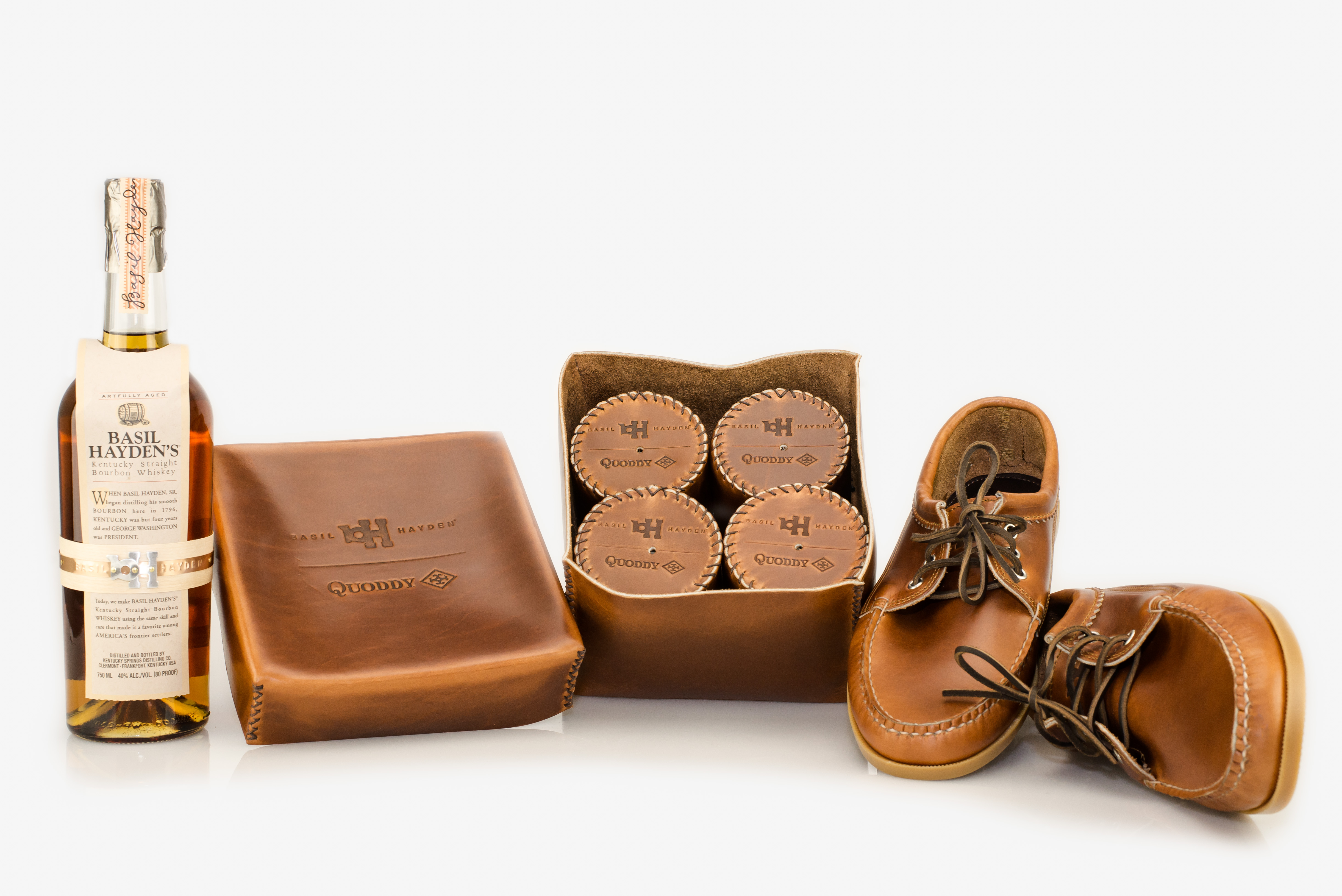 Basil Hayden is planning ahead for its holiday offering with a $400 gift set that features Quoddy shoes and leather-wrapped glasses.
