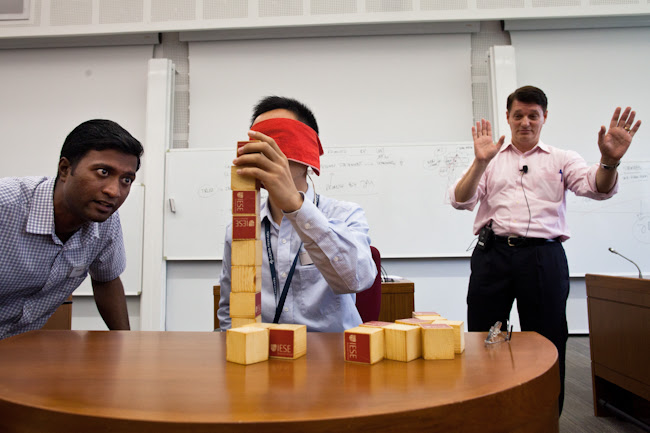 CEIBS professor Pablo Cardona oversees a block-balancing exercise during the boot camp.
