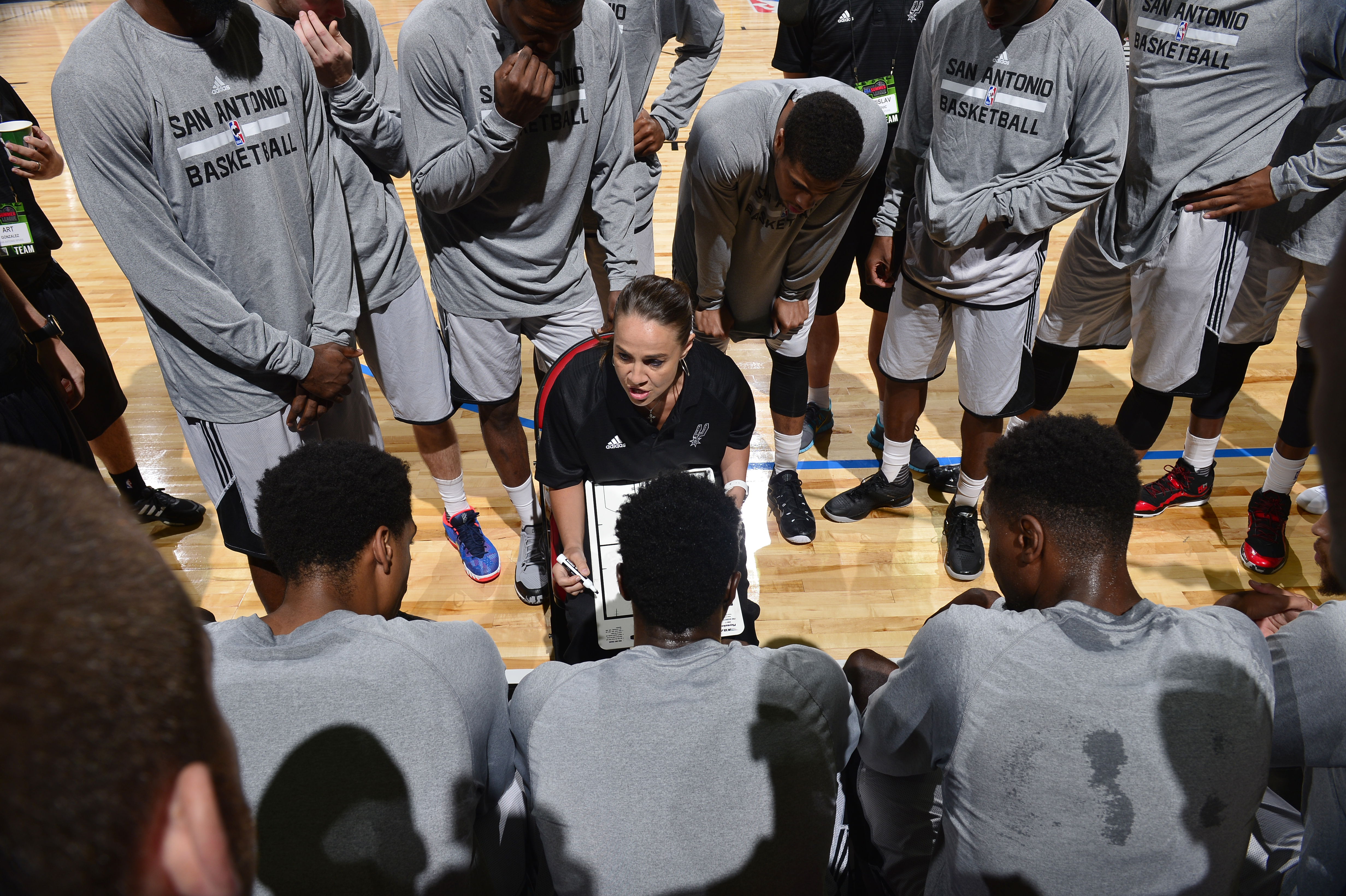Coach Becky Hammon directs a play against the New York Knicks on July 11, 2015 at the Thomas & Mack Center in Las Vegas