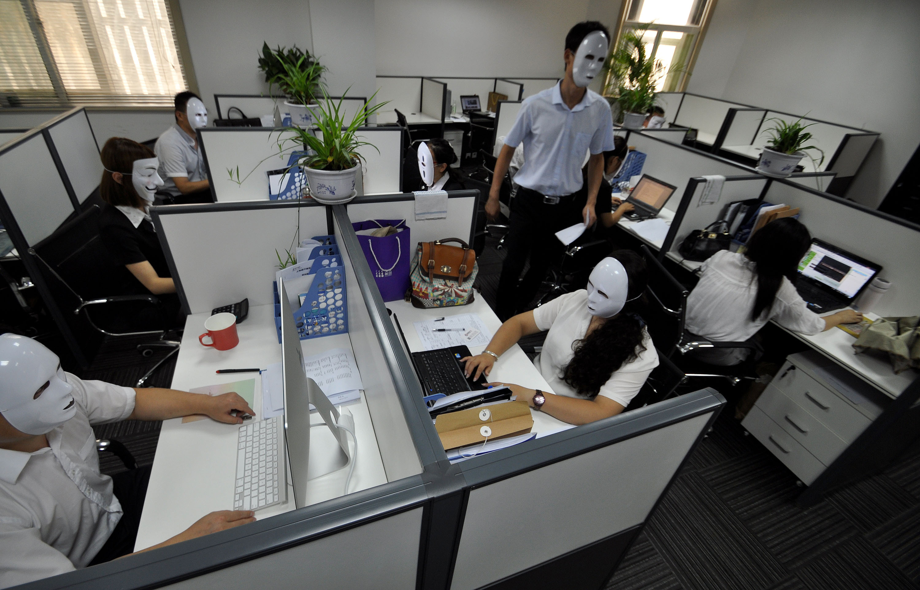Staffs Wear No-Face Masks To Reduce Pressure During Working Time In Handan
