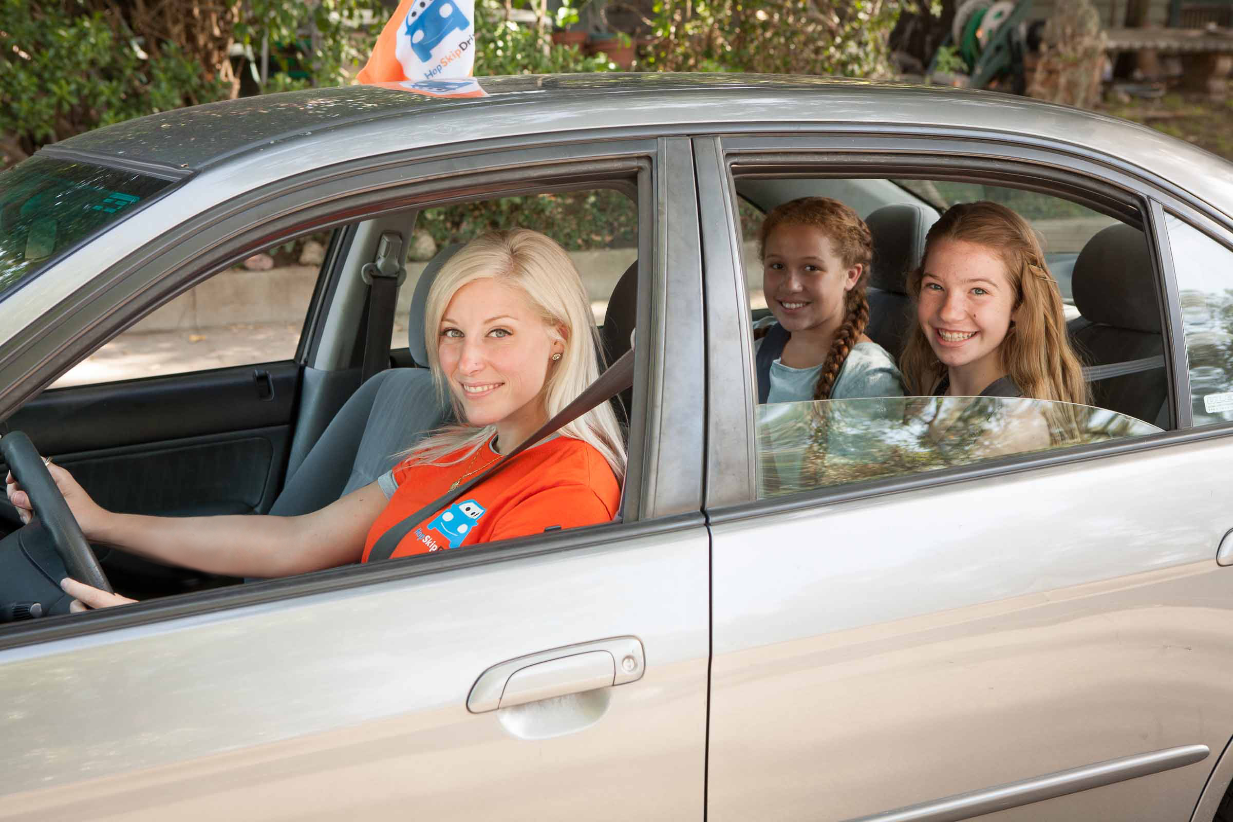 HopSkipDrive CareDriver with passengers.