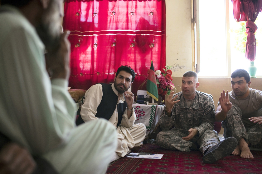 NANGALAM, AFGHANISTAN - SEPTEMBER 12: Elders from the Shuryak Valley speak with US Army's LTC Brian Pearl, 2nd right, battalion commander for the 4th Infantry Division's 4th Brigade, 2 Battalion, 2 - 12 Infantry Regiment at a shura gathering in the Sub-District Governor's office September 12, 2009 in Nangalam, Afghanistan. LTC Pearl had requested a meeting with the Shuryak elders and the local government representative, Mohammad Rahman Danish, center, to discuss construction projects the US Army wants to underwrite. Security issues with taliban forces prevent many work projects from being implemented. (Photo by Robert Nickelsberg/Getty Images)