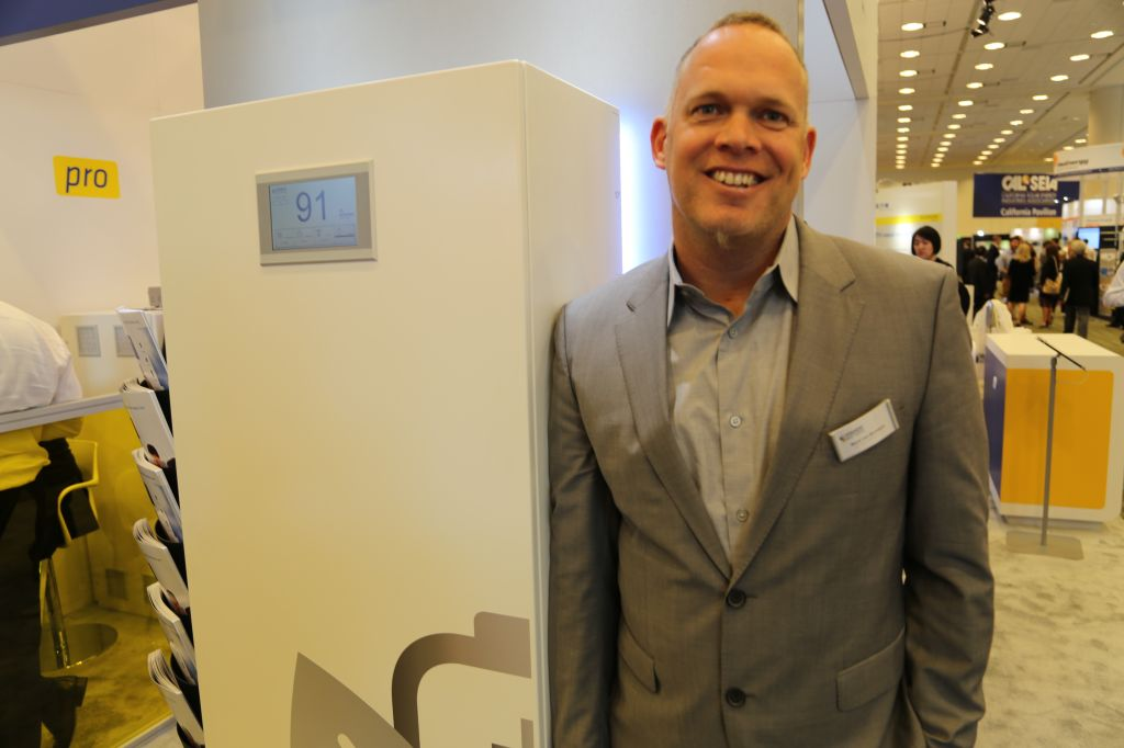 The CEO of Sonnenbatterie, Boris Von Bormann, stands in front of the company's new battery for homes in North America at Intersolar 2015.