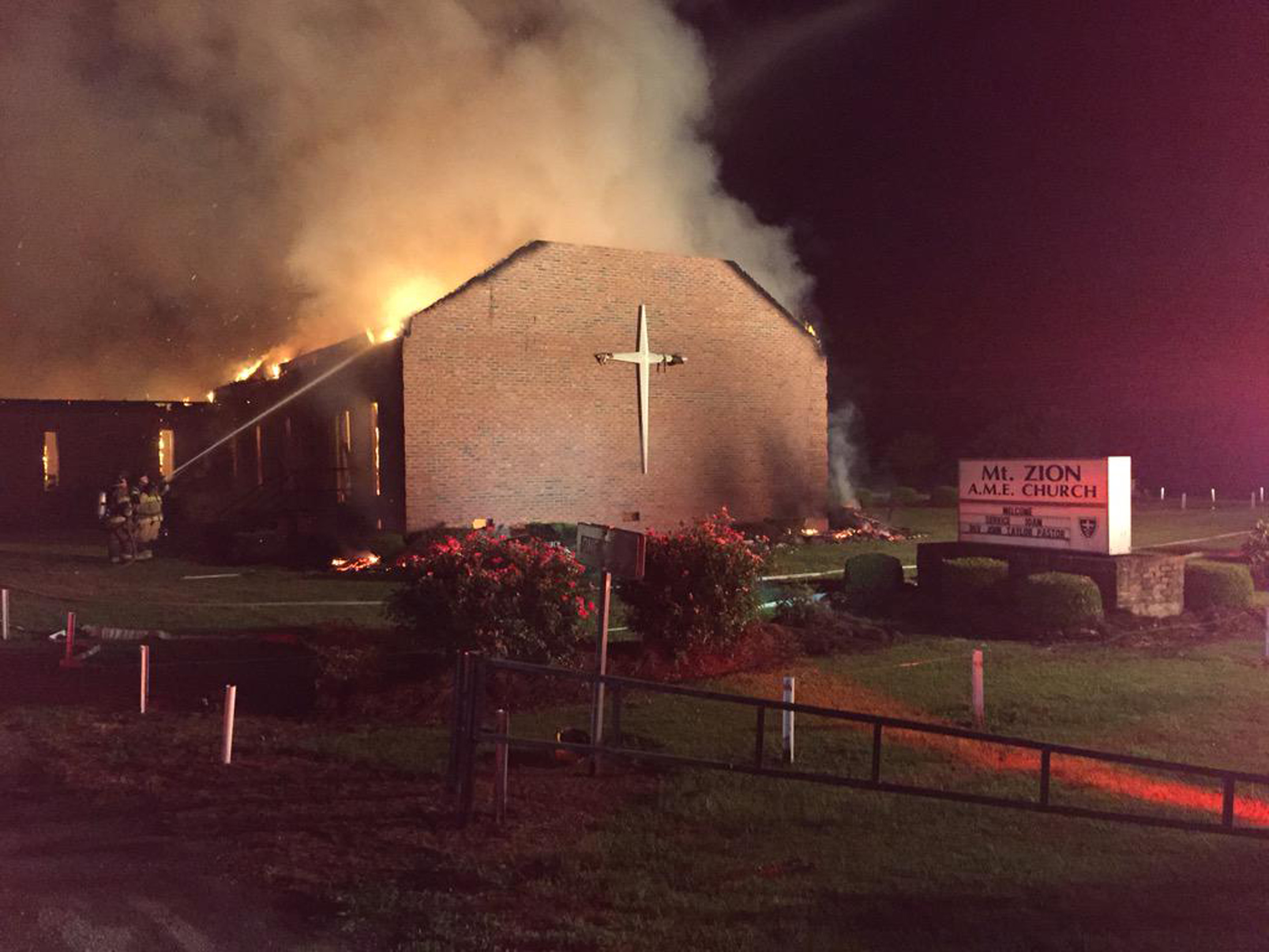 Fire crews try to control a blaze at the Mt. Zion African Methodist Episcopal Church in Greeleyville, South Carolina in this handout photo