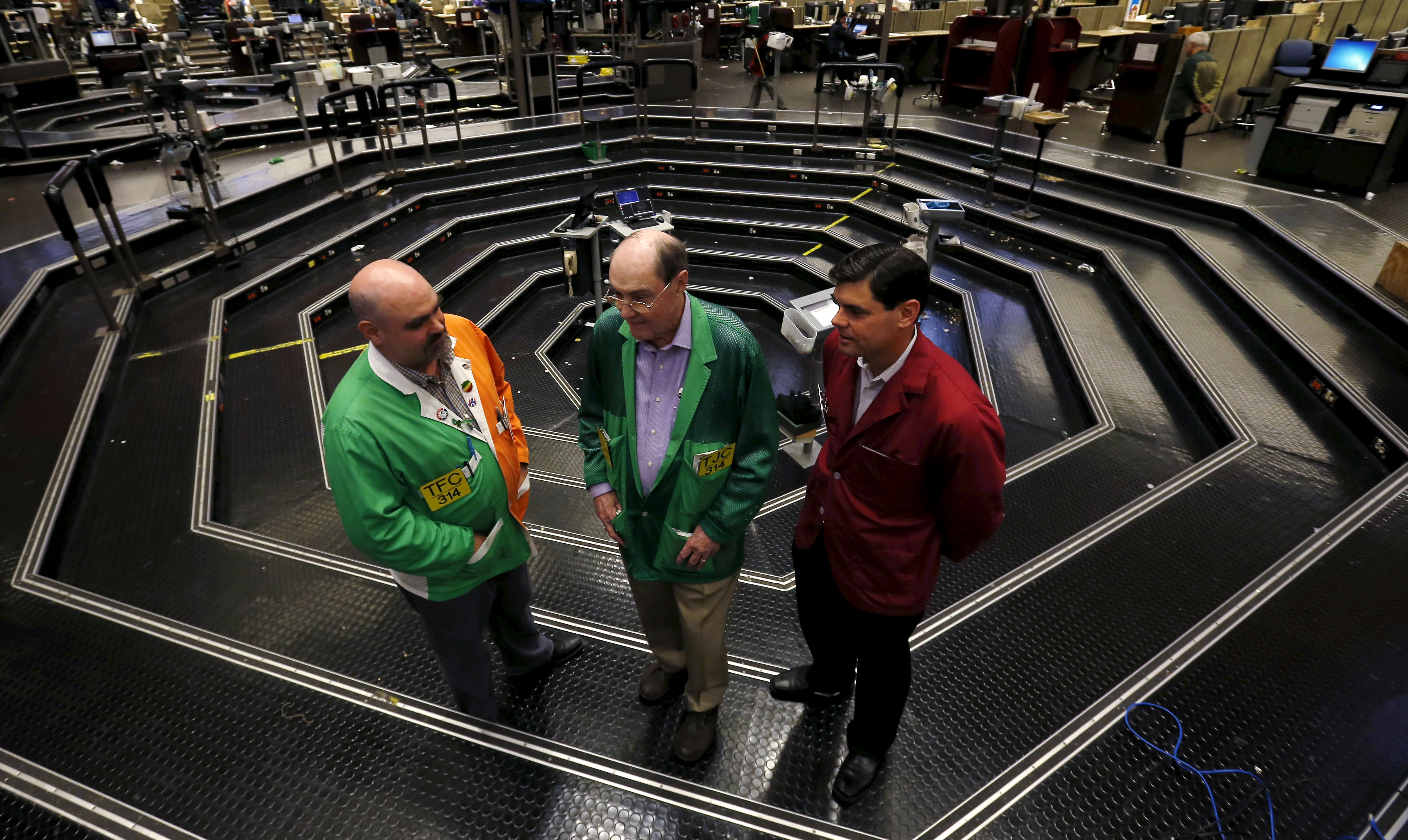 Thomas J. Cashman is joined by his two sons Thomas F. Cashman and Brendon Eugene Cashman on the Chicago Board of Trade grain trading floor in Chicago
