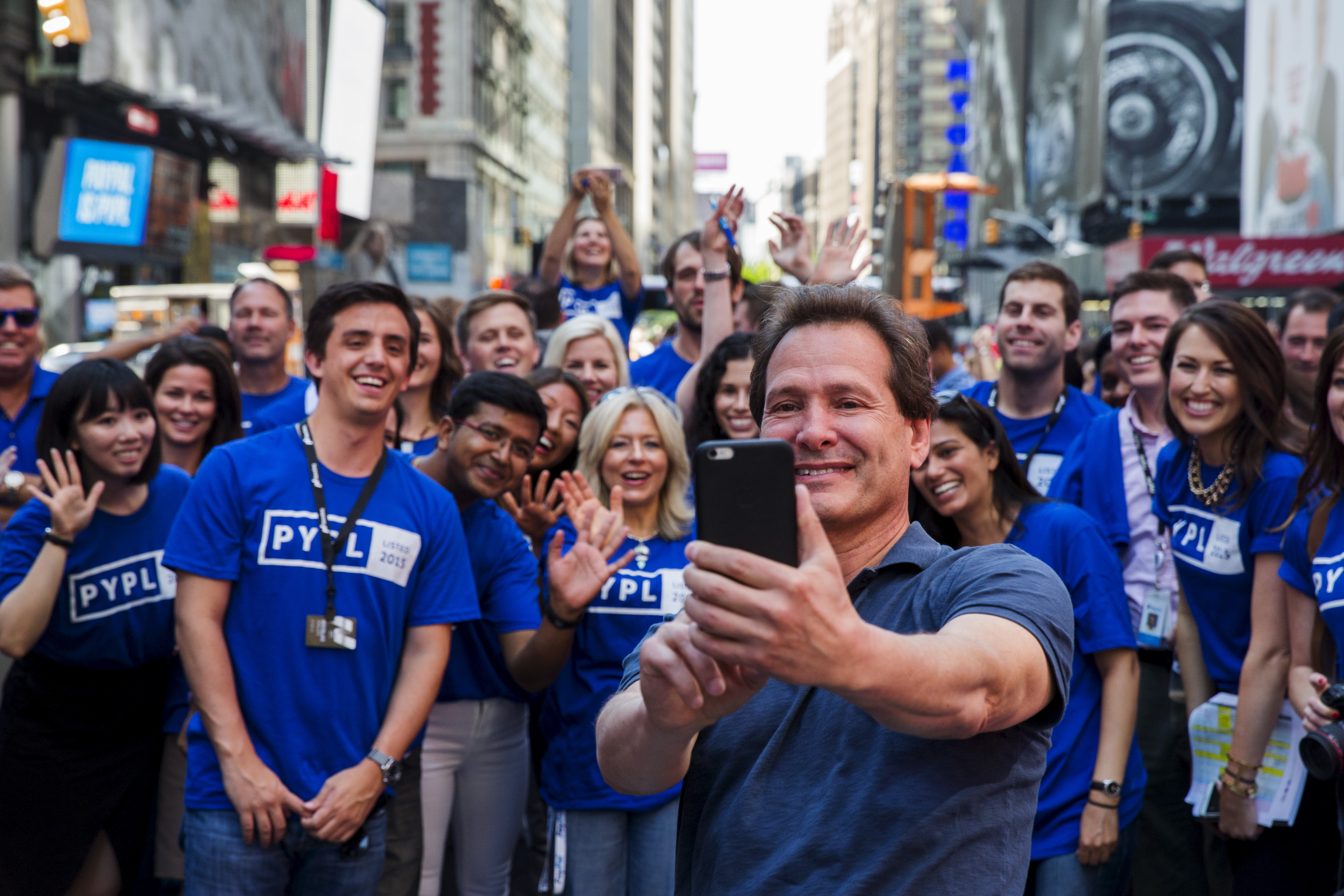 Paypal CEO Dan Schulman celebrates with employees after the company's relisting on the Nasdaq in New York