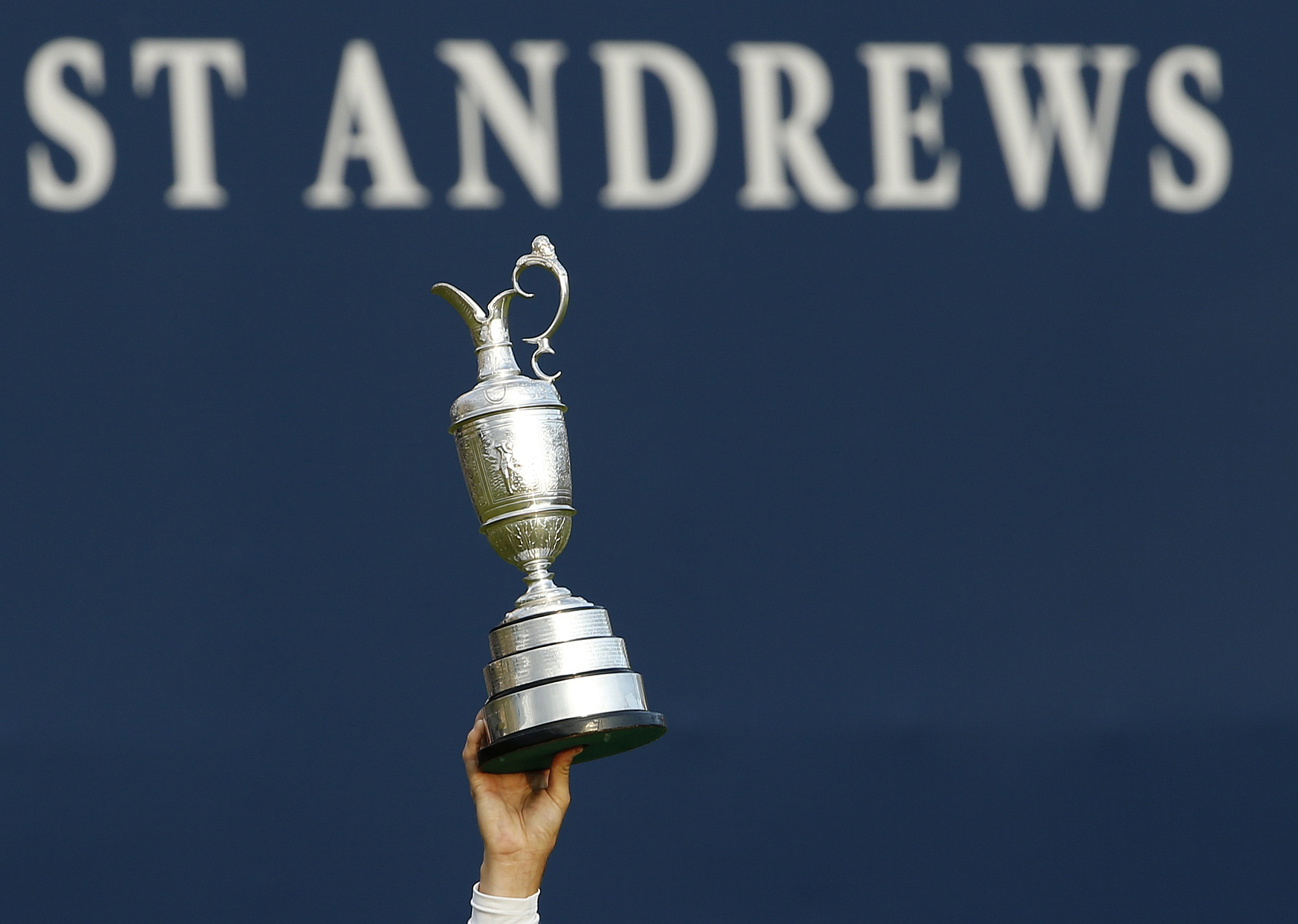 Johnson of the U.S. celebrates as he holds the Claret Jug after winning the British Open golf championship on the Old Course in St. Andrews, Scotland