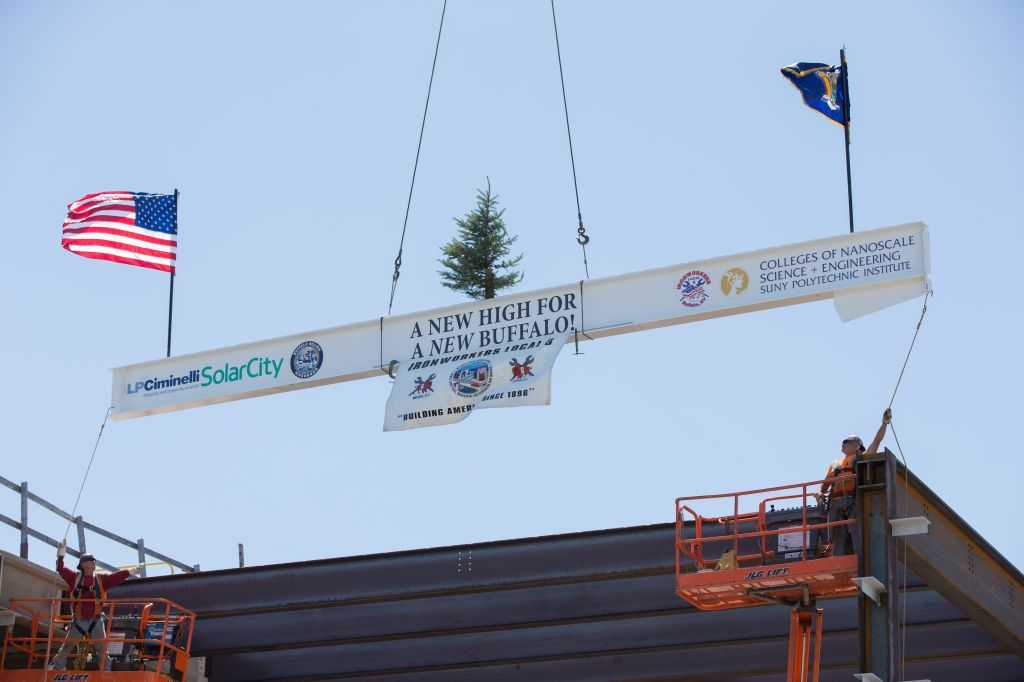 """The """"topping off"""" ceremony at SolarCity's factory in upstate New York."""