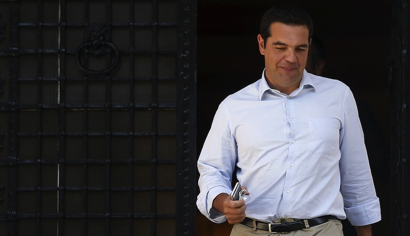 Greek Prime Minister Alexis Tsipras leaves his office at Maximos Mansion in Athens Thursday.