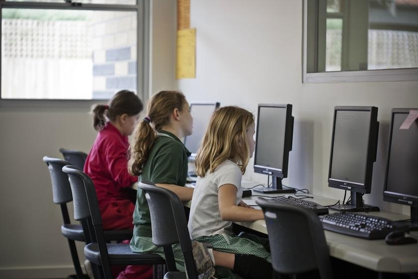 School children in classroom.