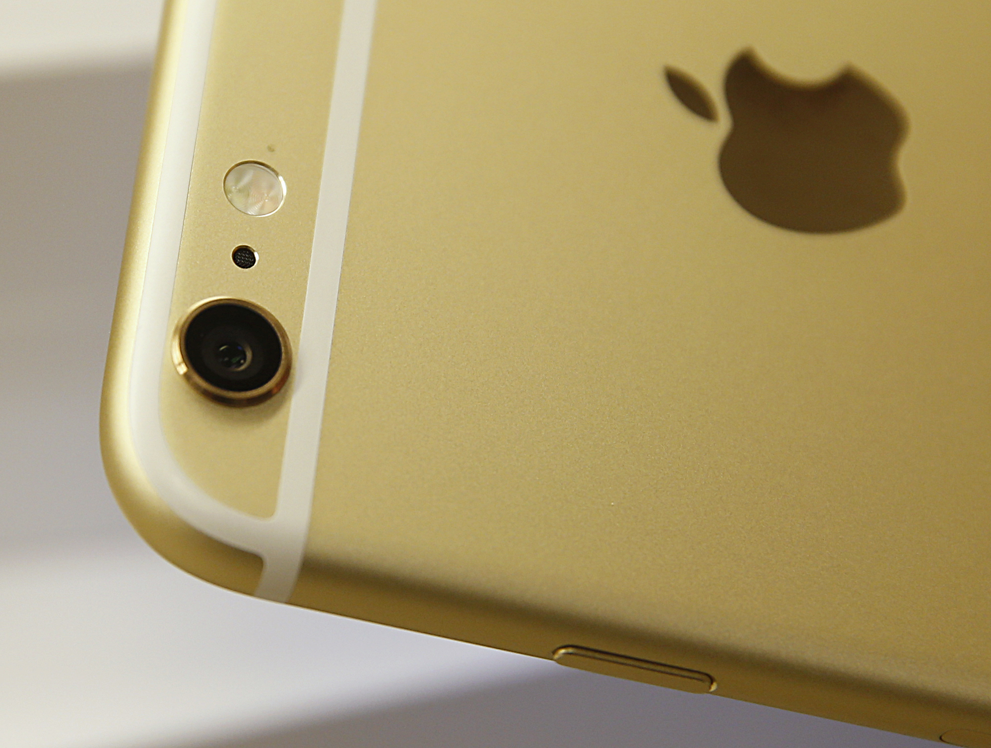The camera and flash of an Apple iPhone 6 Plus.