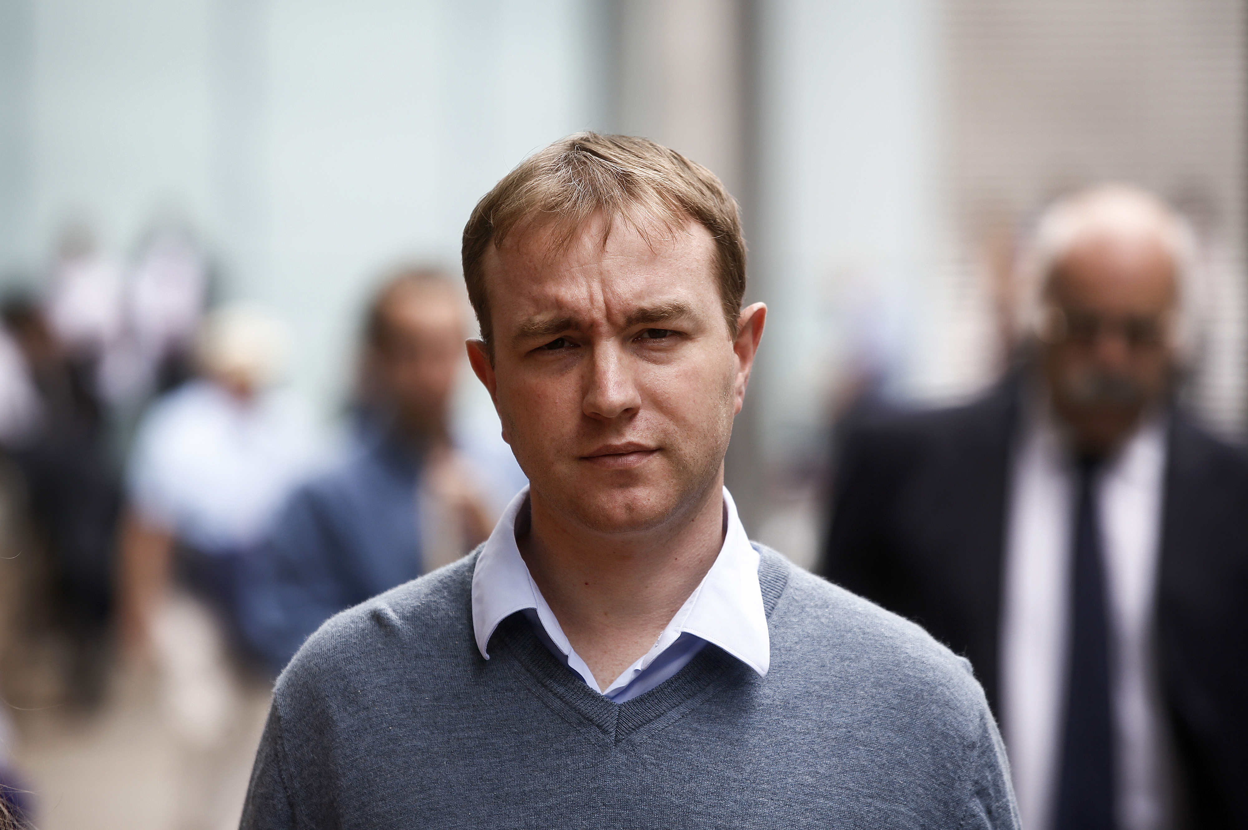 Thomas 'Tom' Hayes, a former trader at banks including UBS Group AG and Citigroup Inc., leaves for lunch during for his trial at Southwark Crown Court in London, U.K., on Monday, Aug. 03, 2015. Hayes, the first person to stand trial for manipulating Libor, was found guilty of eight counts of conspiracy to rig the benchmark rate. Photographer: Simon Dawson/Bloomberg *** Local Caption *** Tom Hayes