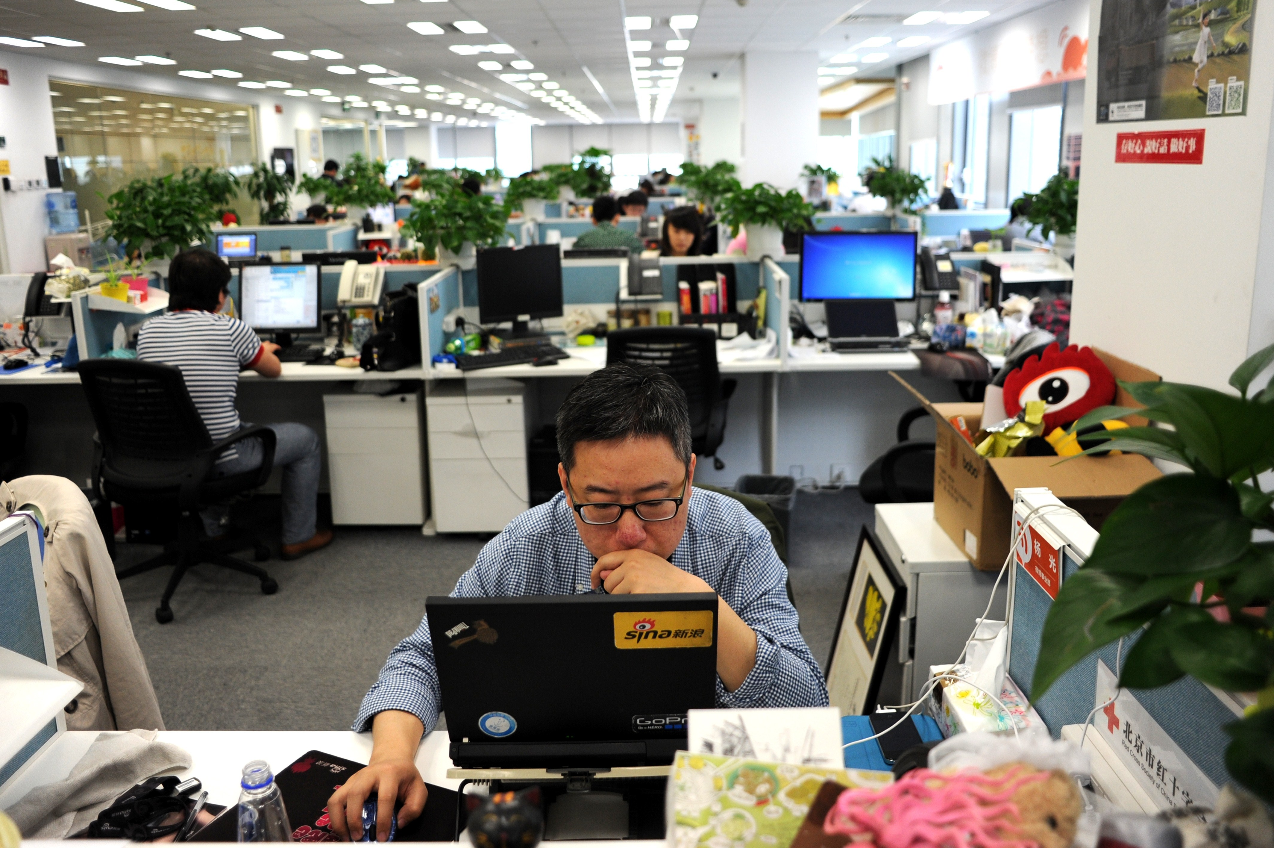 A man using a laptop at an office of Sina Weibo, widely known as China's version of Twitter, in Beijing.