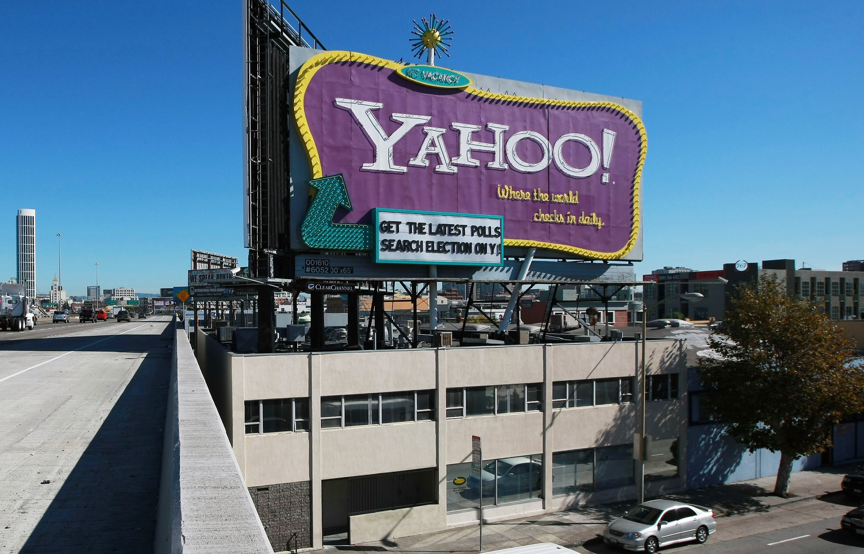 Cars drive by the landmark Yahoo billboard on October 21, 2008, in San Francisco, Calif.