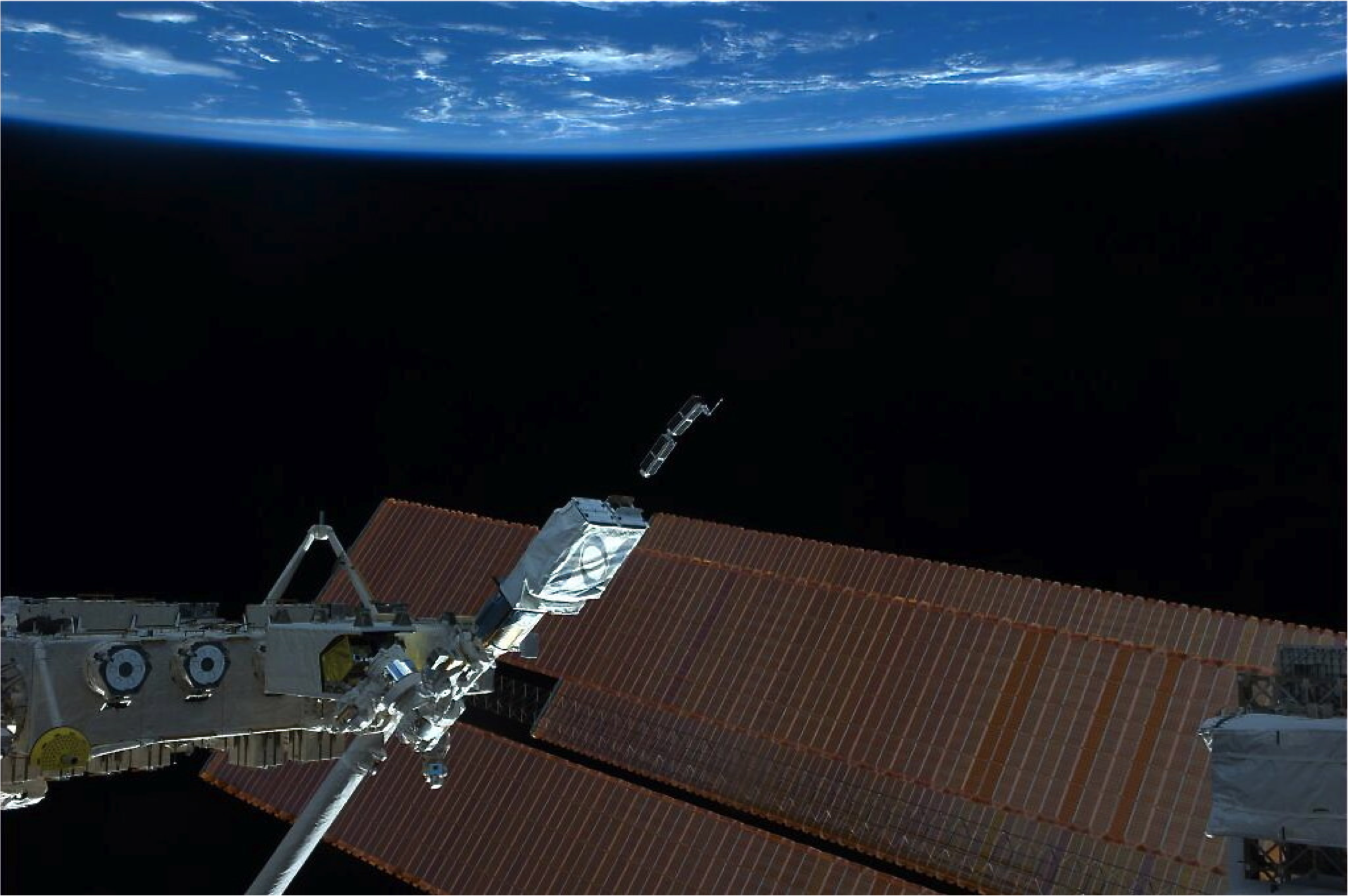 Two Planet Labs Dove satellites being deployed from the ISS in February 2014.