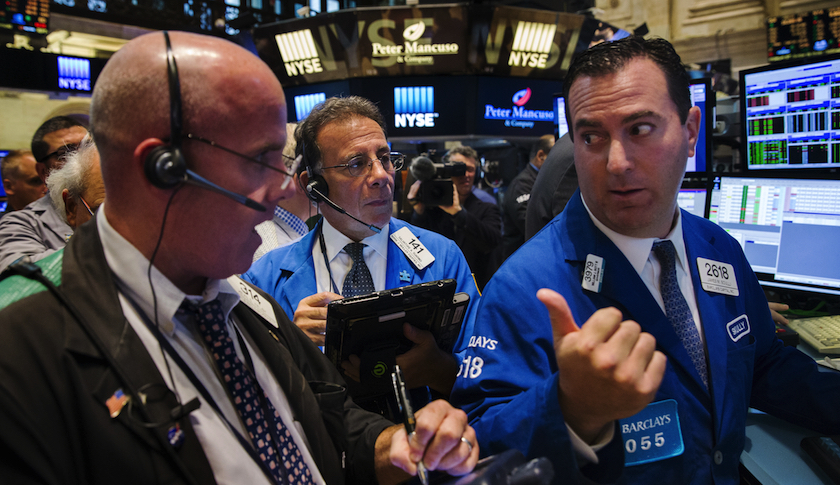 Traders on the floor of the New York Stock Exchange shortly after the opening bell in New York Wednesday