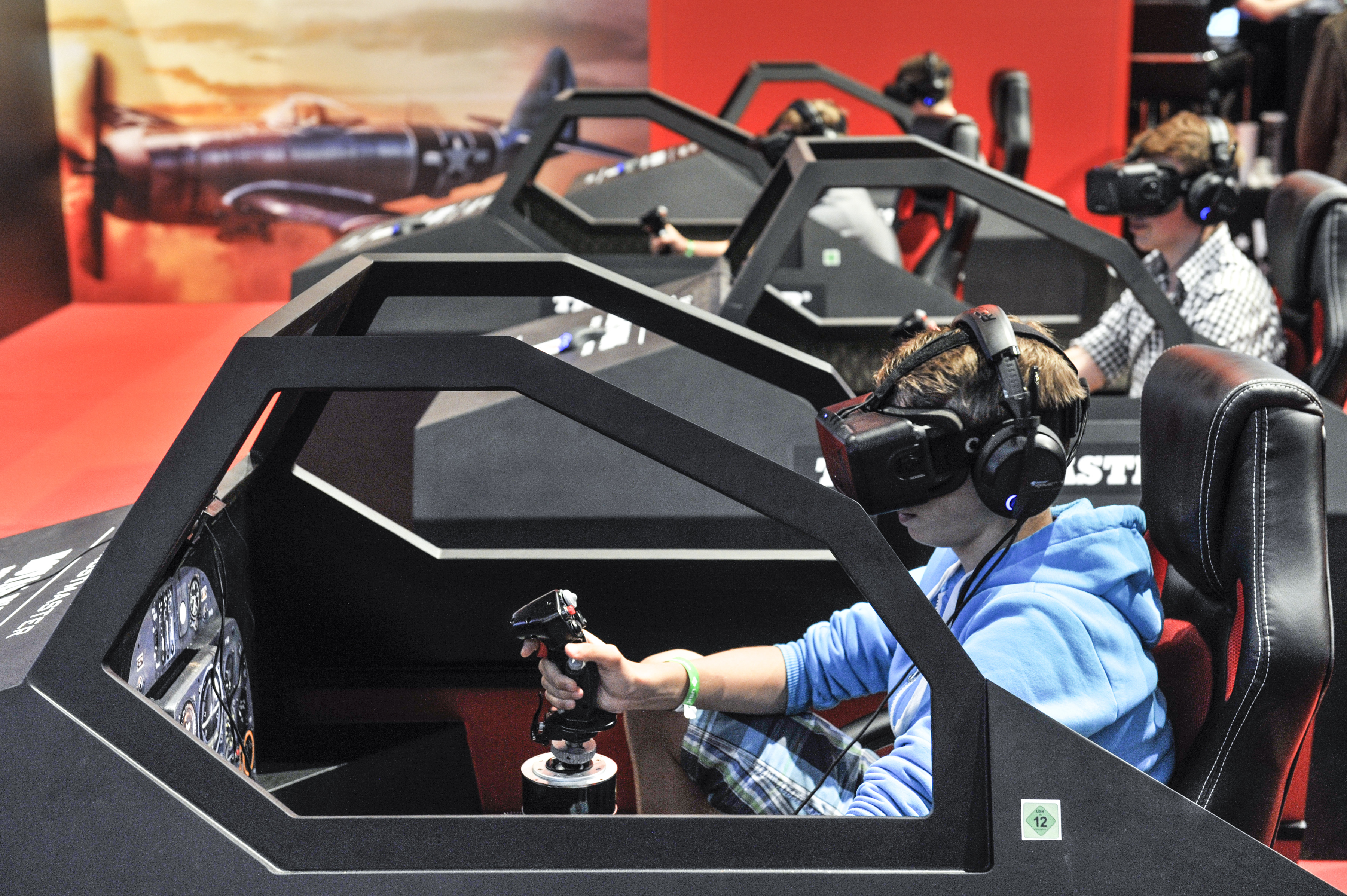 At Gamescom, the world's largest video game convention, players fight in WWII dogfights in War Thunder on Oculus Rift.