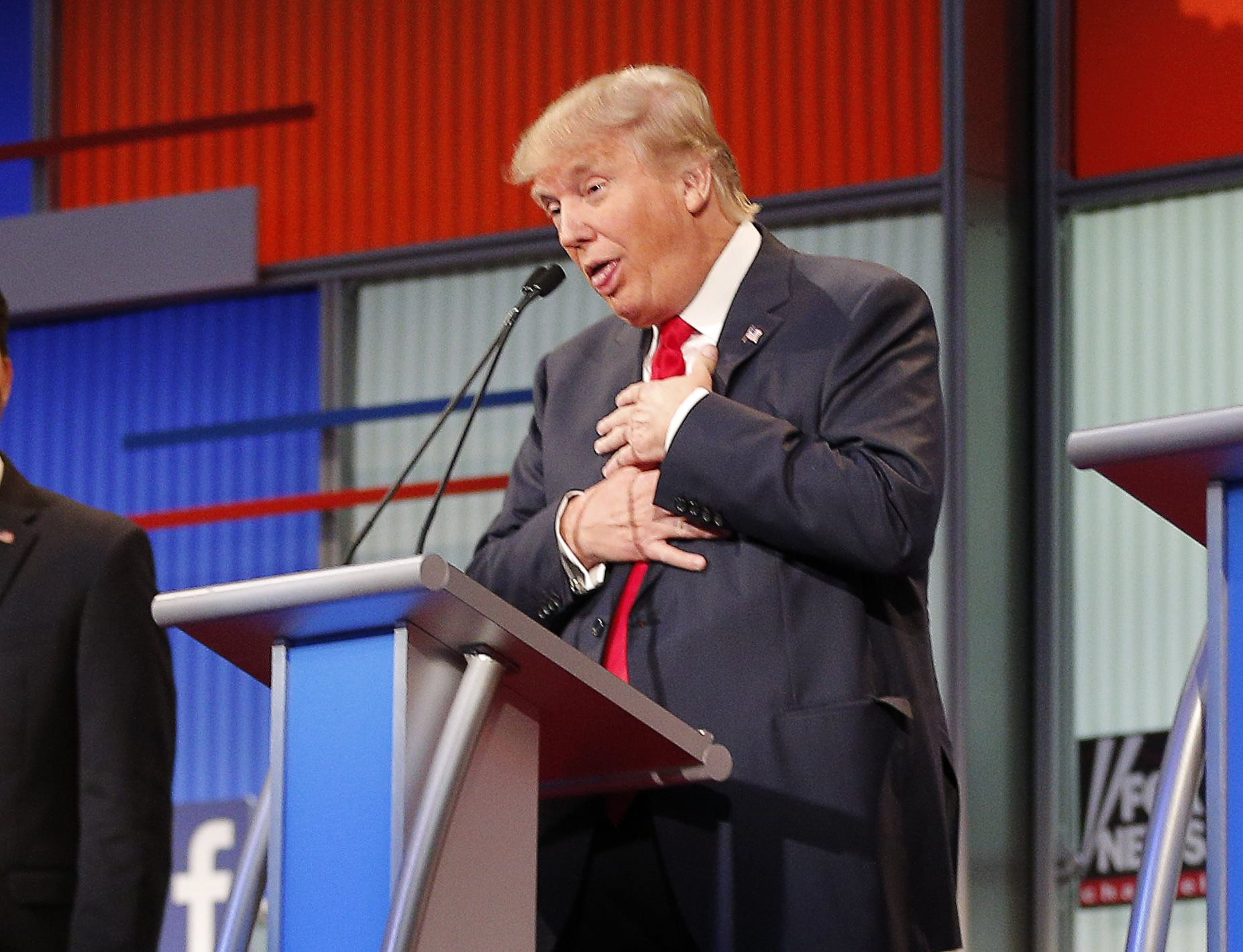 Republican 2016 U.S. presidential candidate and businessman Donald Trump reacts near the end of the first official Republican presidential candidates debate of the 2016 U.S. presidential campaign in Cleveland