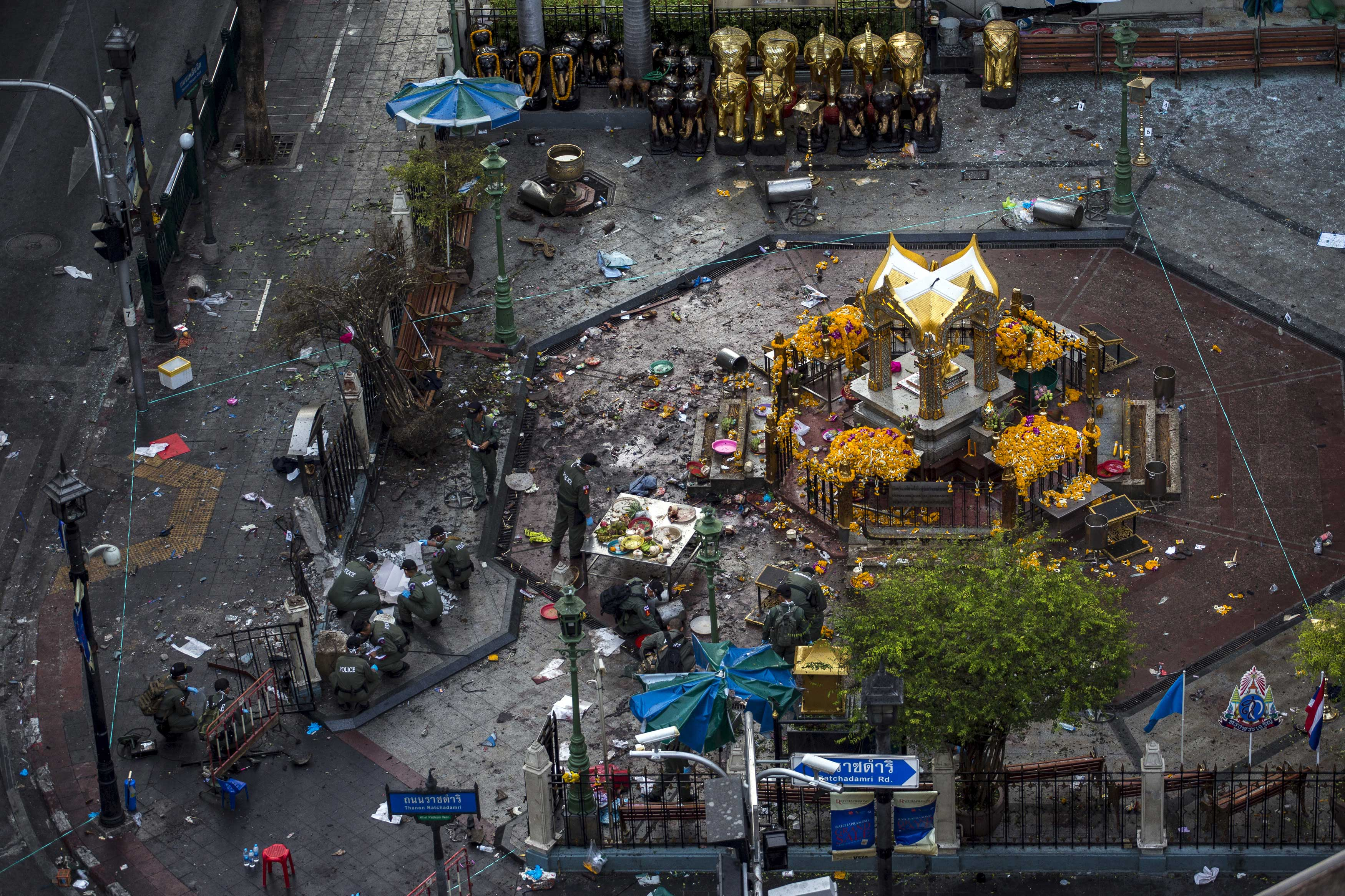 Experts investigate the Erawan shrine, the site of a deadly blast in central Bangkok