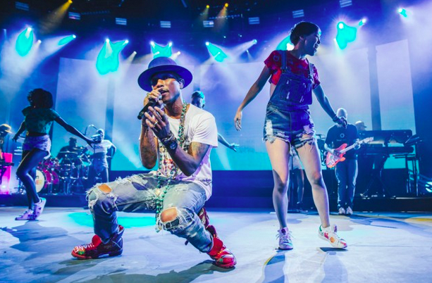Pharrell performing at the 2014 iTunes Music Festival
