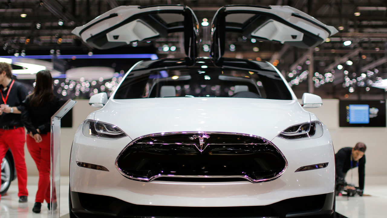 Tesla's Model X features swooping doors, which were later revealed to have contributed to a delay in the car.