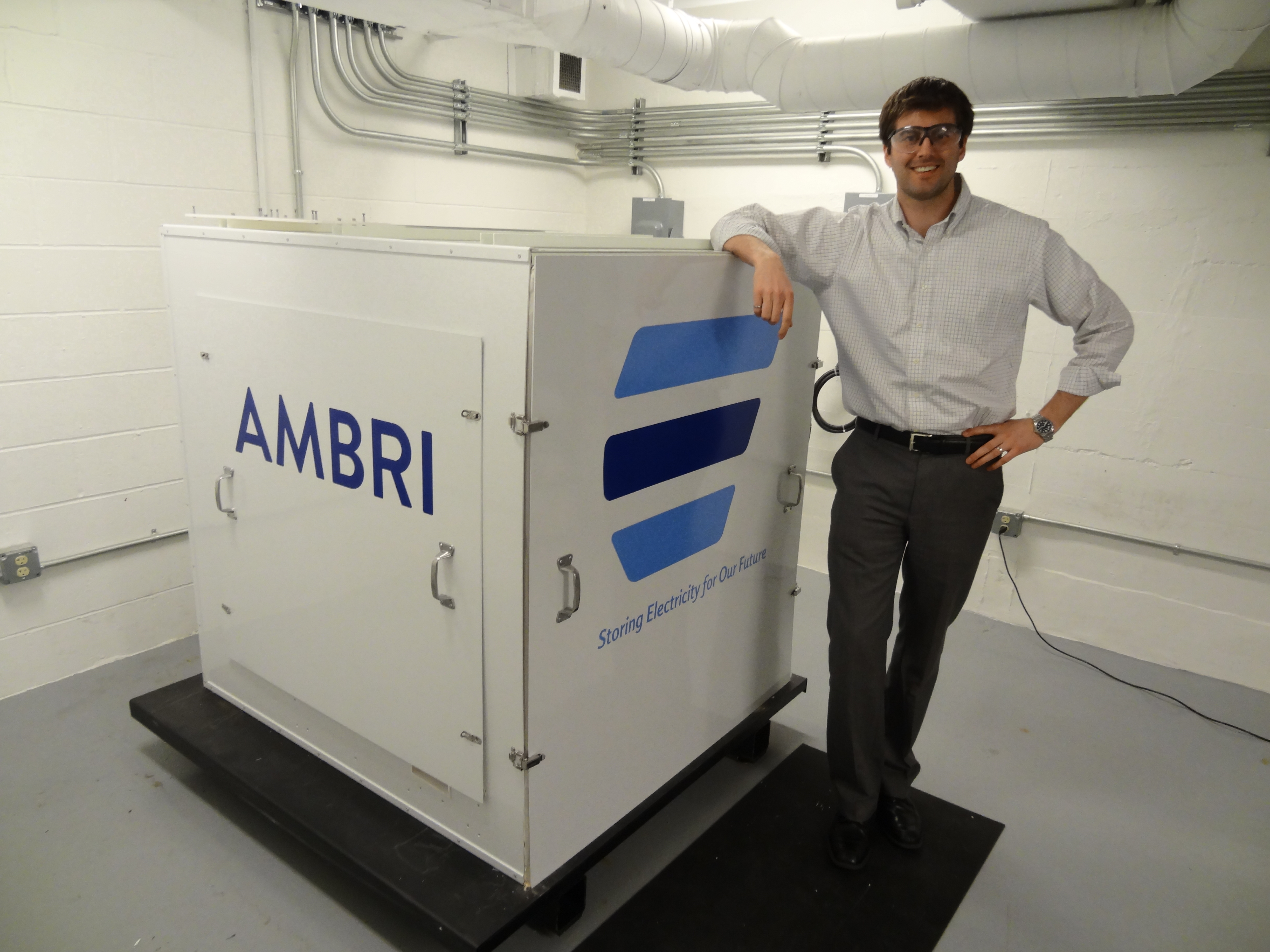 "David Bradwell, Ambri's CTO, standing next to one of Ambri's first lab-based systems, known as the ""Alpha Core"""