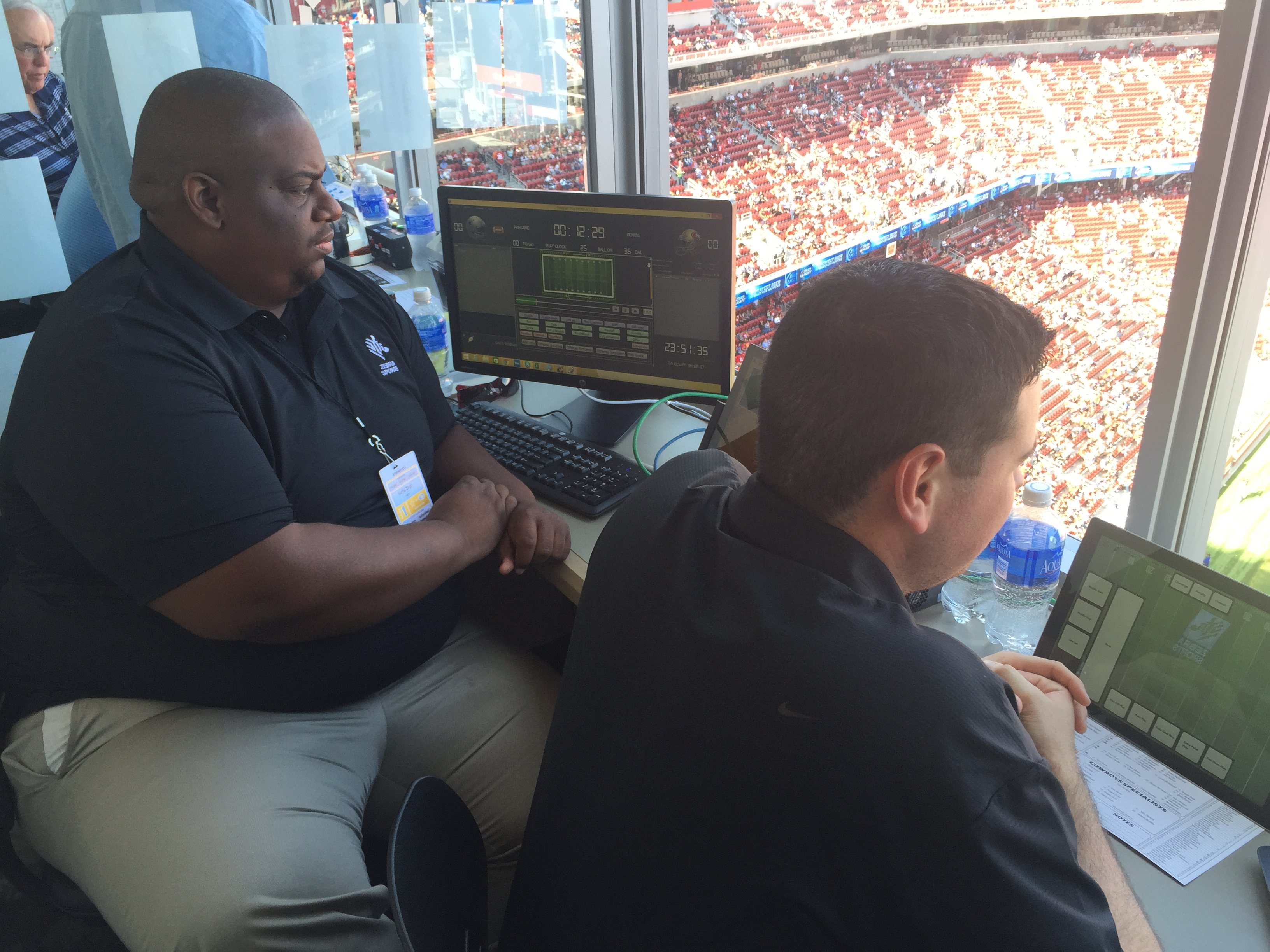 Zebra staff making sure the tech is working at Levi's Stadium during a preseason game.