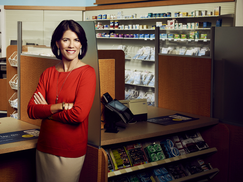 """Foulkes stands in front of the pharmacy counter at a 10,000-square-foot mock-up store on the campus of the CVS Health headquarters in Woonsocket, R.I. As an undergrad econ major at Harvard, she impressed her thesis adviser, Larry Summers, as being """"extraordinarily effective."""""""